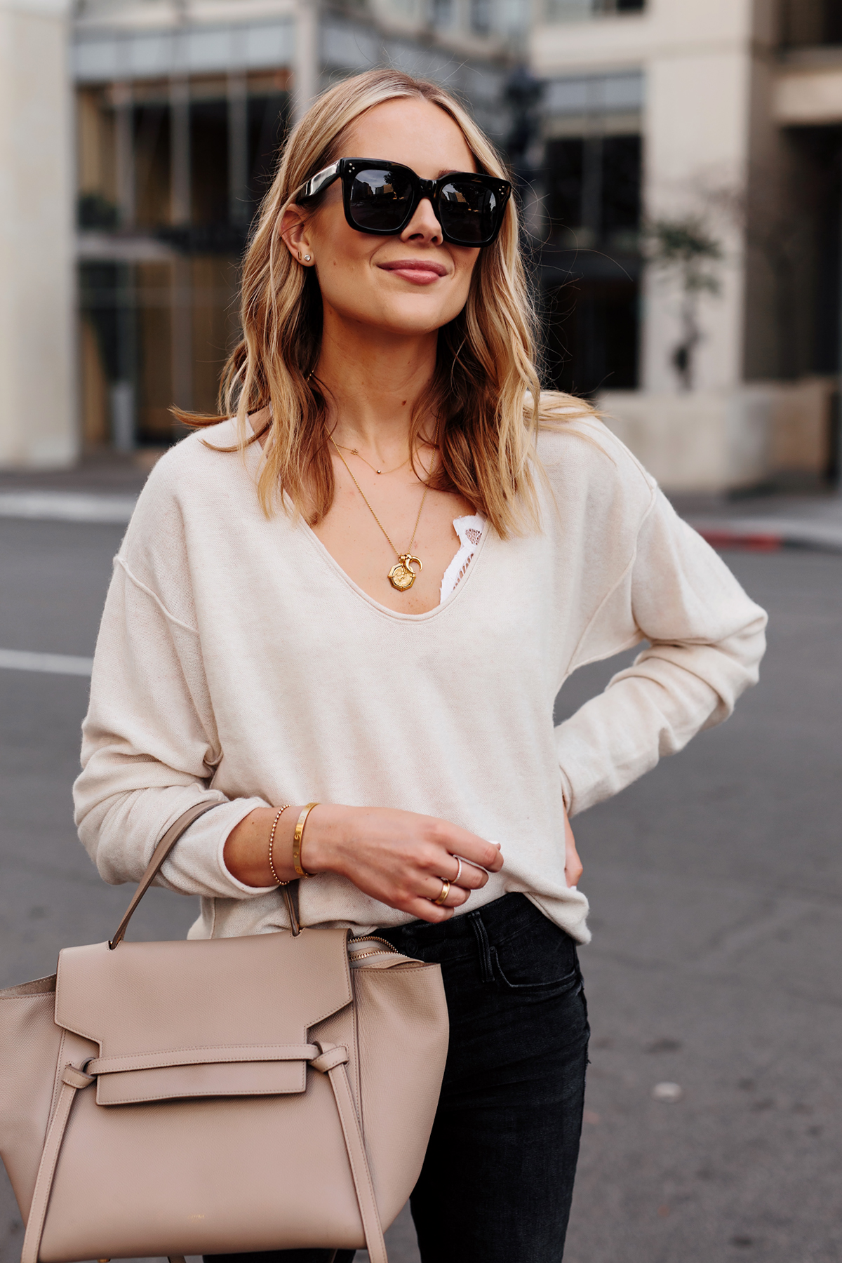 Blonde Woman Wearing Beige Sweater White Lace Bralette Black Skinny Jeans Celine Mini Belt Bag Dainty Gold Jewelry Fashion Jackson San Diego Fashion Blogger Street Style