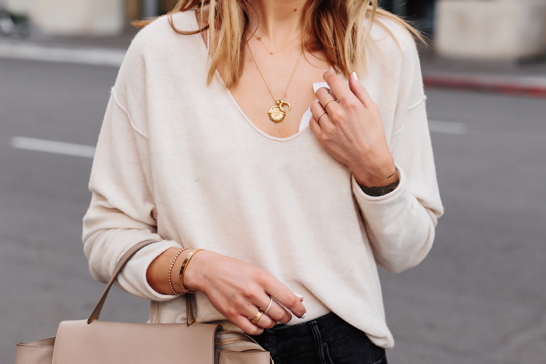 Blonde Woman Wearing Beige Sweater White Lace Bralette Missoma Gold Necklaces Cartier Bracelet Dainty Gold Jewelry Fashion Jackson San Diego Fashion Blogger Street Style