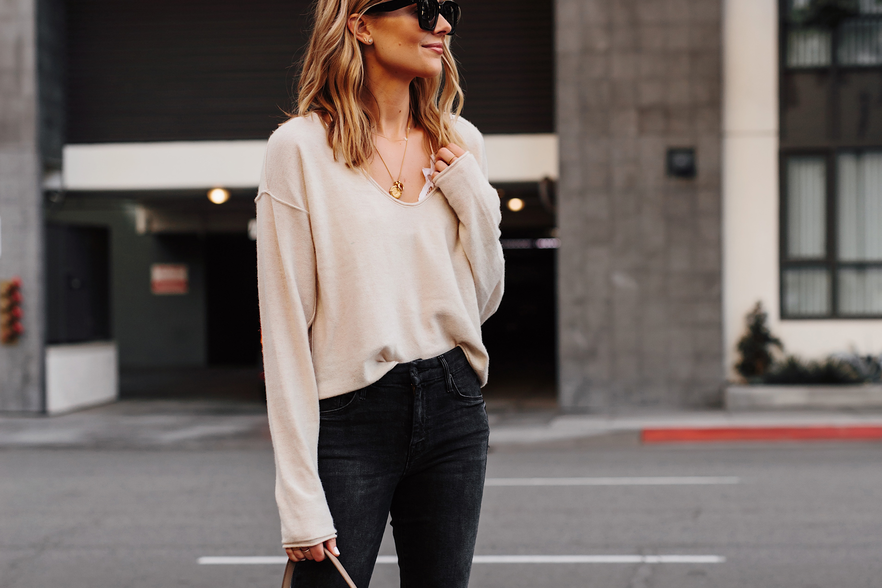 Blonde Woman Wearing Beige Sweater White Lace Bralette Missoma Gold Necklaces Dainty Gold Jewelry Fashion Jackson San Diego Fashion Blogger Street Style