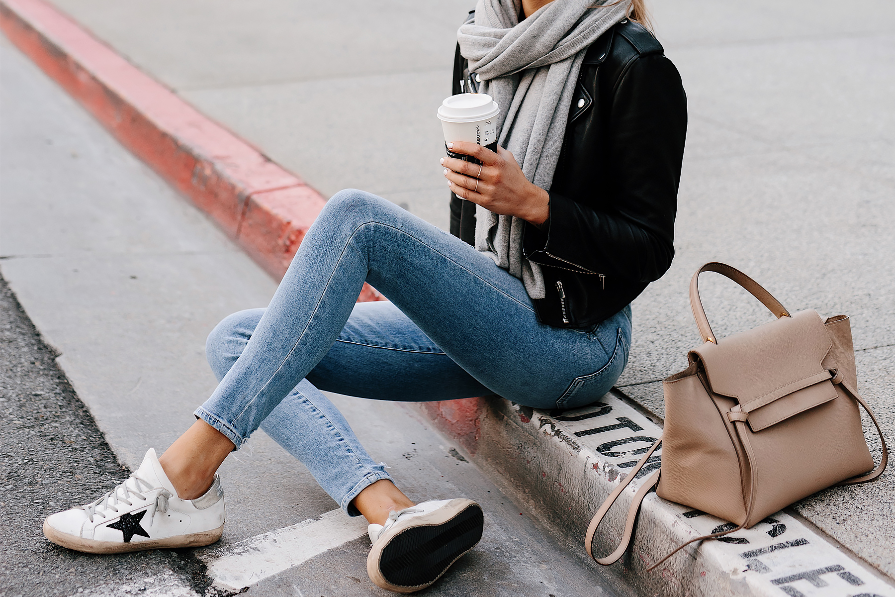 Woman Wearing Black Leather Jacket Grey Scarf Denim Skinny Jeans Golden Goose Sneakers Celine Mini Belt Bag Taupe Fashion Jackson San Diego Fashion Blogger Street Style