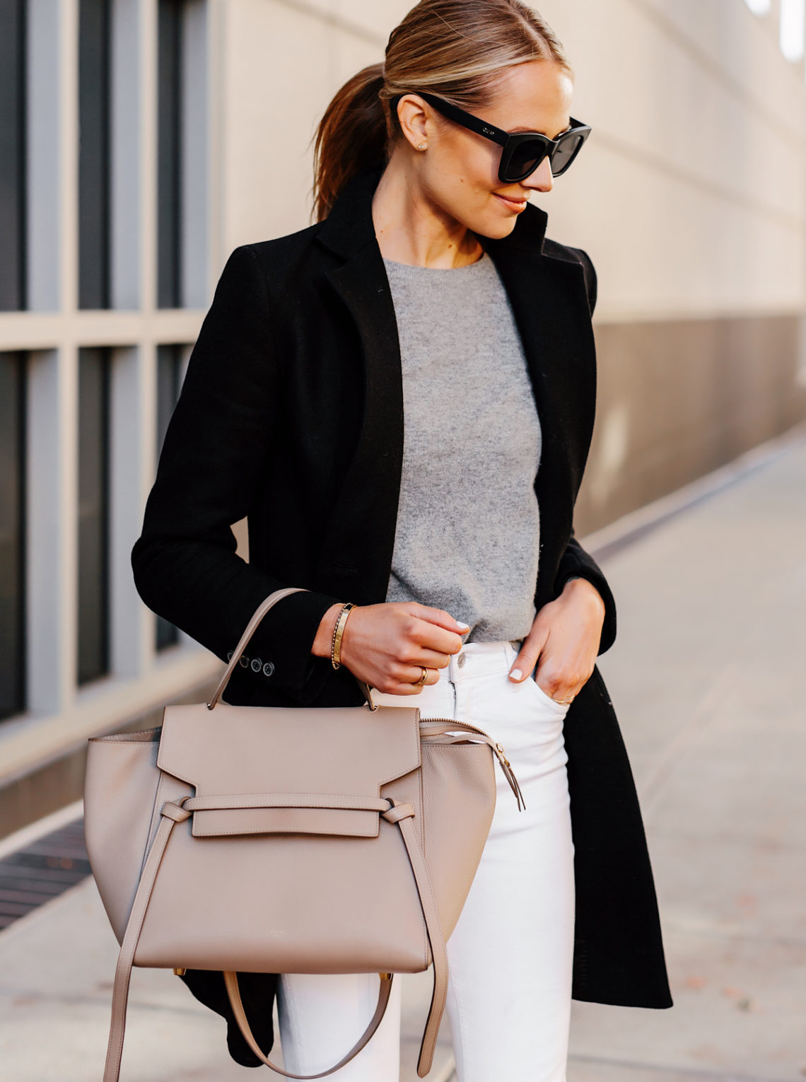 Blonde Woman Wearing Black Wool Coat Grey Sweater White Skinny Jeans Celine Mini Belt Bag Fashion Jackson San Diego Fashion Blogger Street Style