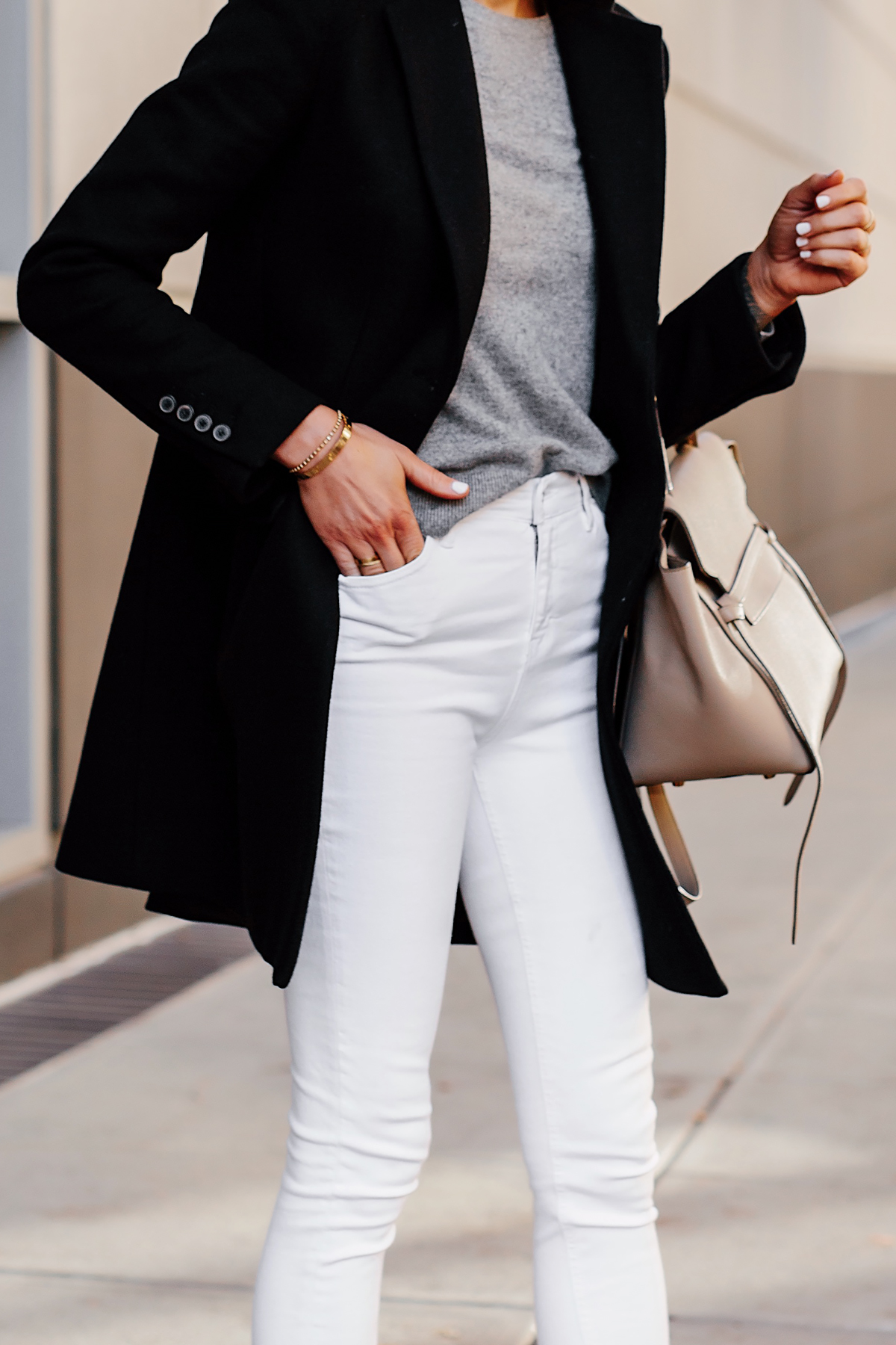 Woman Wearing Black Wool Coat Grey Sweater White Skinny Jeans Celine Mini Belt Bag Fashion Jackson San Diego Fashion Blogger Street Style