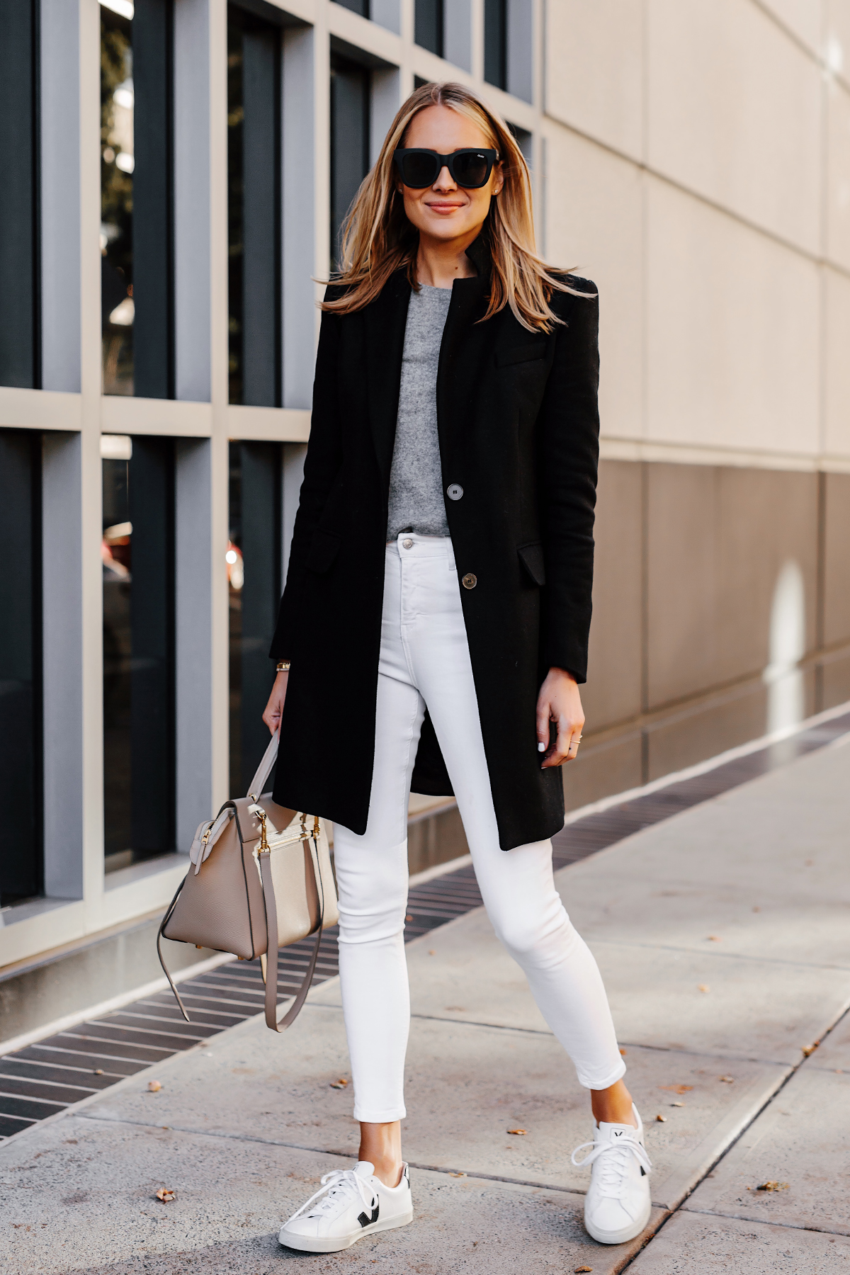 Blonde Woman Wearing Black Wool Coat Grey Sweater White Skinny Jeans Veja Sneakers Celine Mini Belt Bag Fashion Jackson San Diego Fashion Blogger Street Style