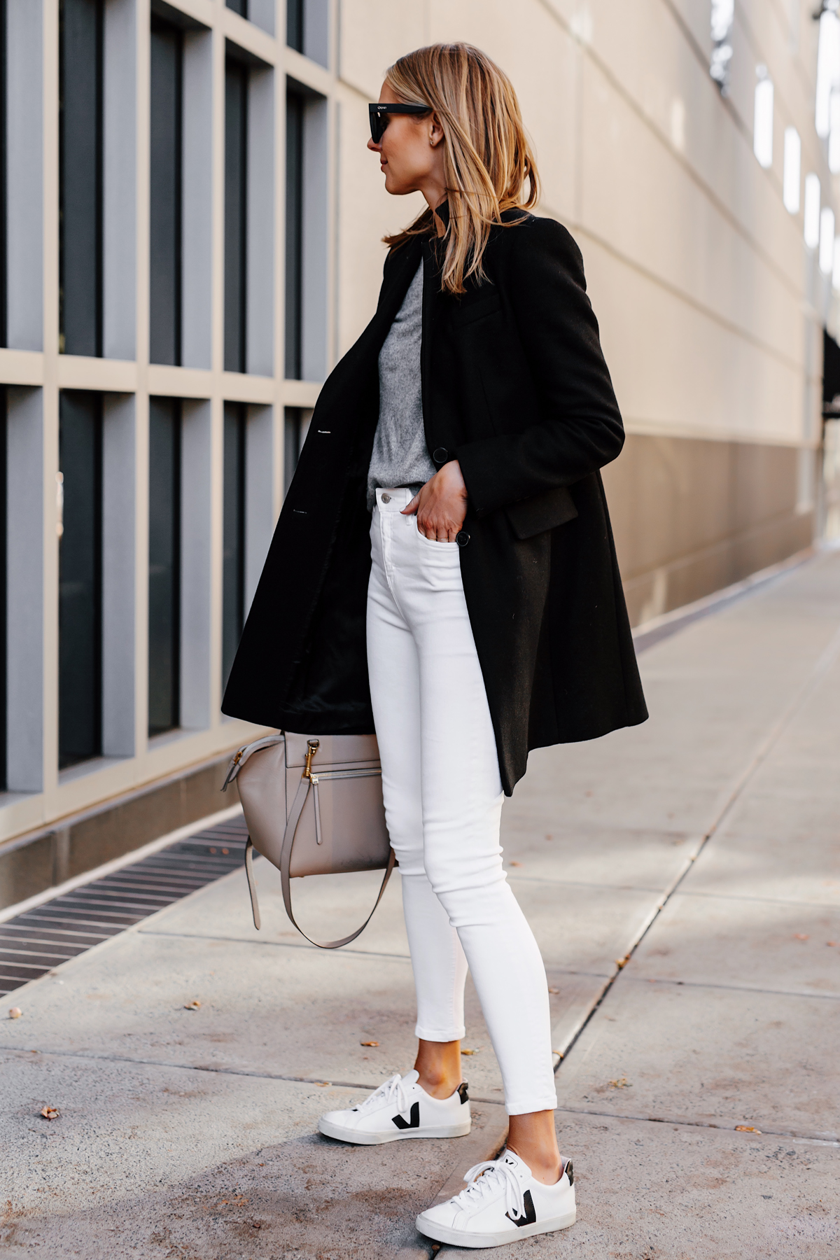 Blonde Woman Wearing Black Wool Coat Grey Sweater White Skinny Jeans Veja Sneakers Fashion Jackson San Diego Fashion Blogger Street Style