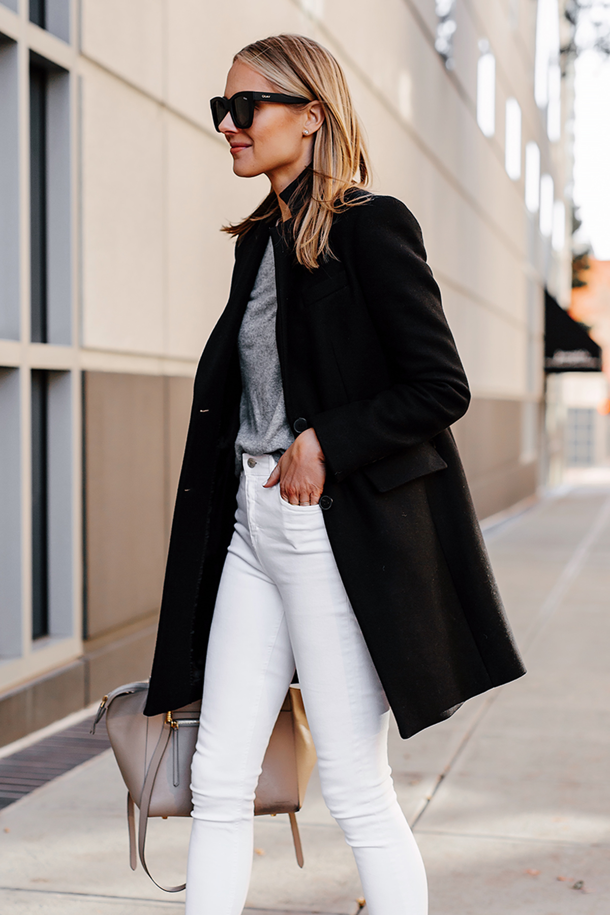 Blonde Woman Wearing Black Wool Coat Grey Sweater White Skinny Jeans Fashion Jackson San Diego Fashion Blogger Street Style
