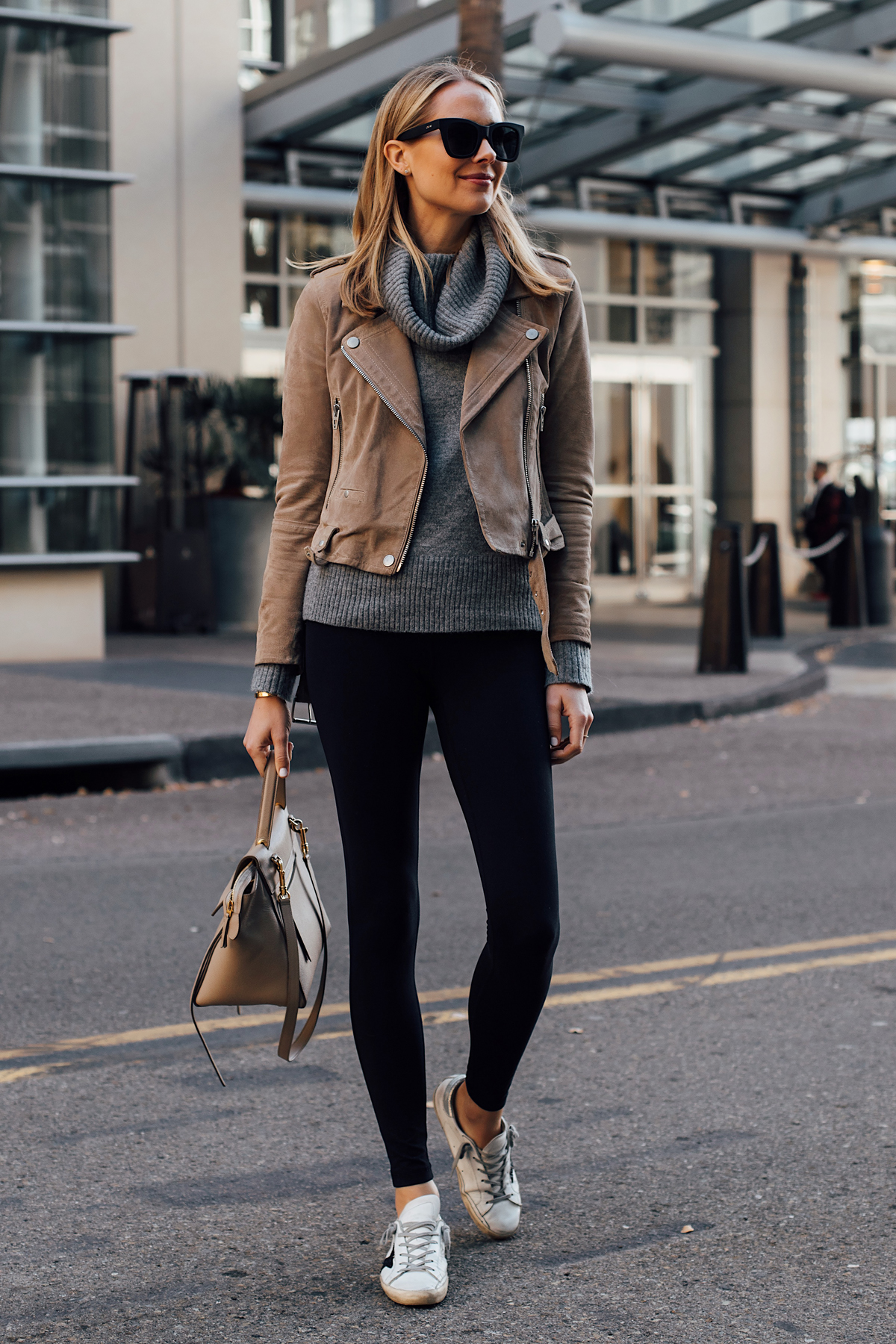 Blonde Woman Wearing Blanknyc Tan Suede Moto Jacket Grey Turtleneck Sweater Black Leggings Golden Goose Sneakers Celine Mini Belt Bag Fashion Jackson San Diego Fashion Blogger Street Style