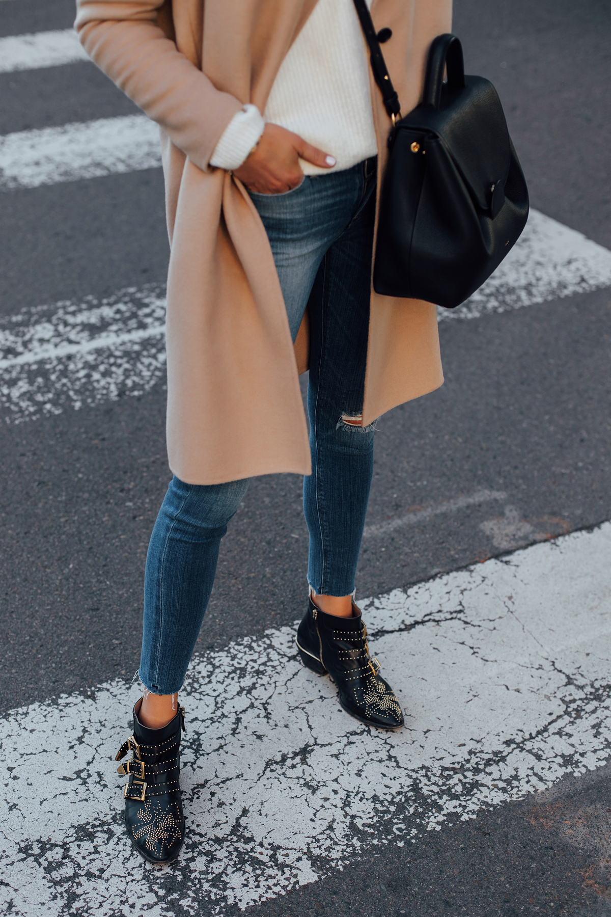 Woman Wearing Camel Coat White Sweater Denim Skinny Jeans Chloe Susanna Booties Polene Black Handbag Fashion Jackson San Diego Fashion Blogger Street Style