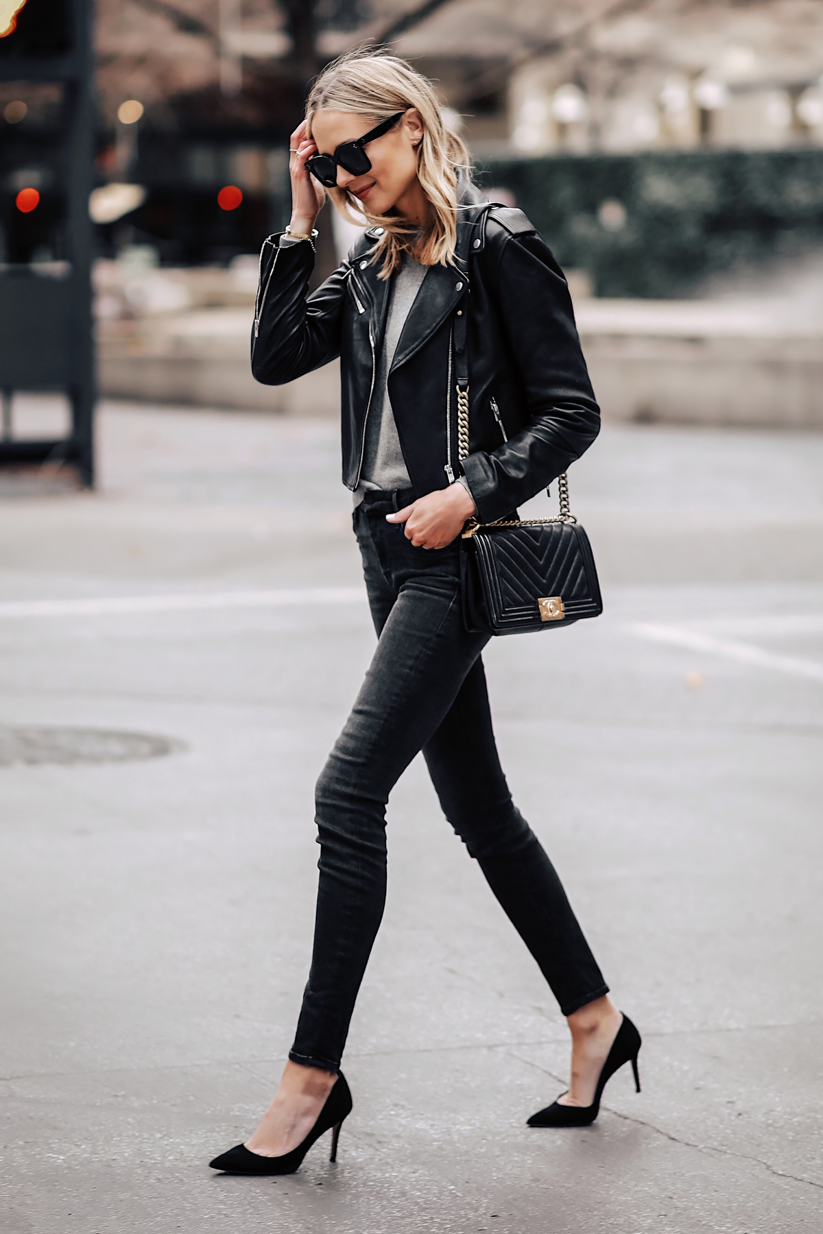 Blonde Woman Wearing Club Monaco Black Leather Jacket Grey Sweater Black  Skinny Jeans Black Pumps Chanel