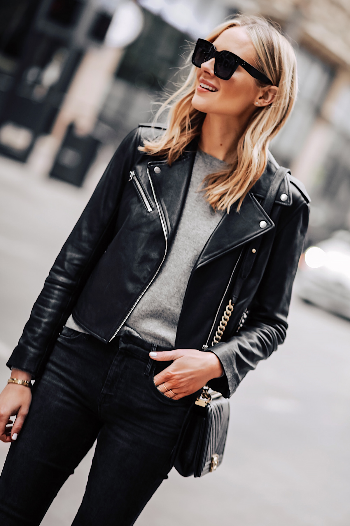 Blonde Woman Wearing Club Monaco Black Leather Jacket Grey Sweater Black Skinny Jeans Fashion Jackson San Diego Fashion Blogger Street Style