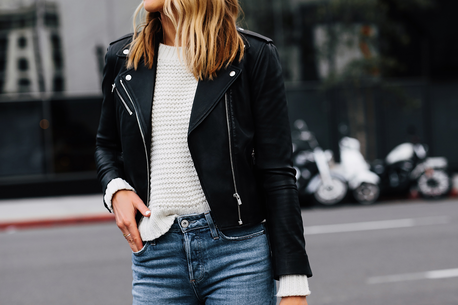 Blonde Woman Wearing Club Monaco Black Leather Jacket Ivory Chunky Sweater Blue Jeans Fashion Jackson San Diego Fashion Blogger Street Style