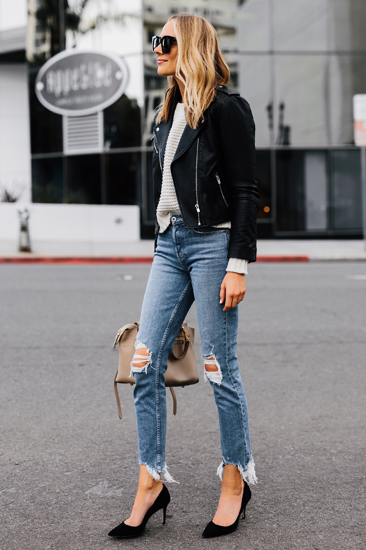 Blonde Woman Wearing Club Monaco Black Leather Jacket Ivory Chunky Sweater Paige Ripped Jeans Black Pumps Fashion Jackson San Diego Fashion Blogger Street Style