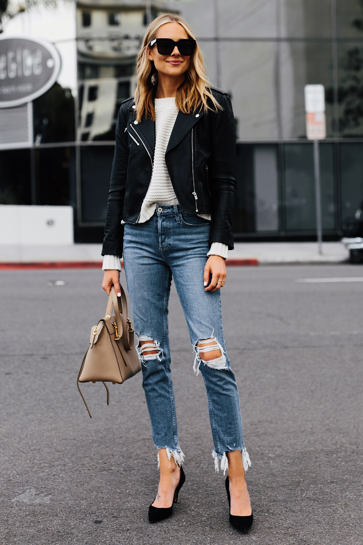 Blonde Woman Wearing Club Monaco Black Leather Jacket Ivory Chunky Sweater Paige Ripped Jeans Black Pumps Celine Mini Belt Bag Fashion Jackson San Diego Fashion Blogger Street Style