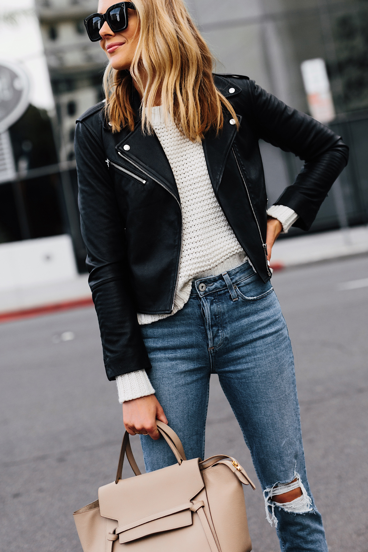 Blonde Woman Wearing Club Monaco Black Leather Jacket Ivory Chunky Sweater Paige Ripped Jeans Celine Mini Belt Bag Fashion Jackson San Diego Fashion Blogger Street Style