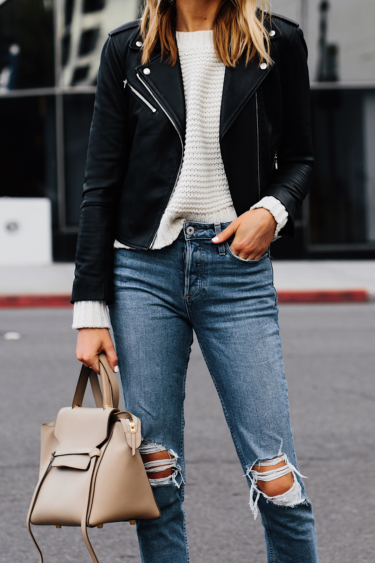 Blonde Woman Wearing Club Monaco Black Leather Jacket Ivory Chunky Sweater Paige Ripped Jeans Fashion Jackson San Diego Fashion Blogger Street Style
