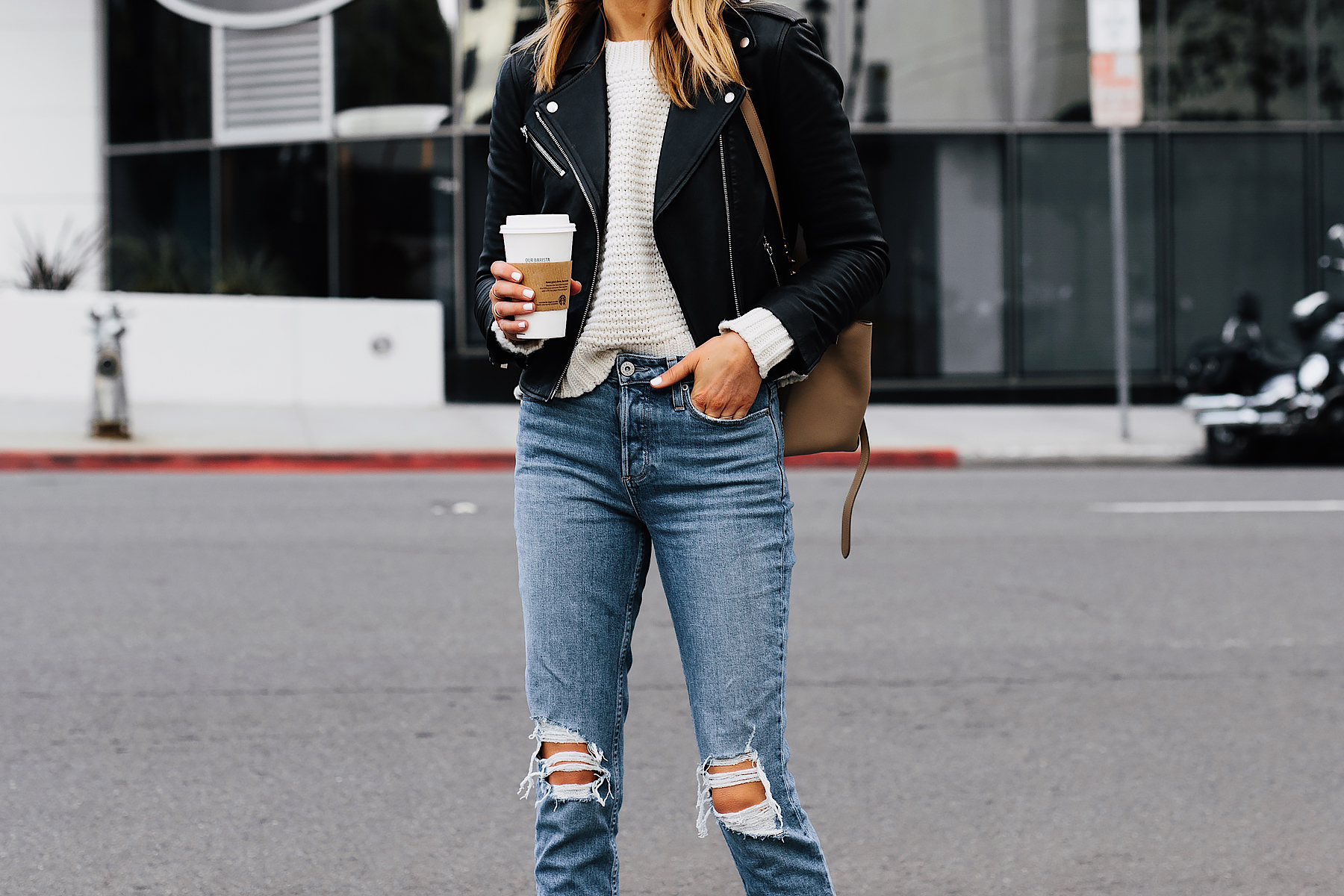 Woman Wearing Club Monaco Black Leather Jacket Ivory Chunky Sweater Paige Ripped Jeans Fashion Jackson San Diego Fashion Blogger Street Style