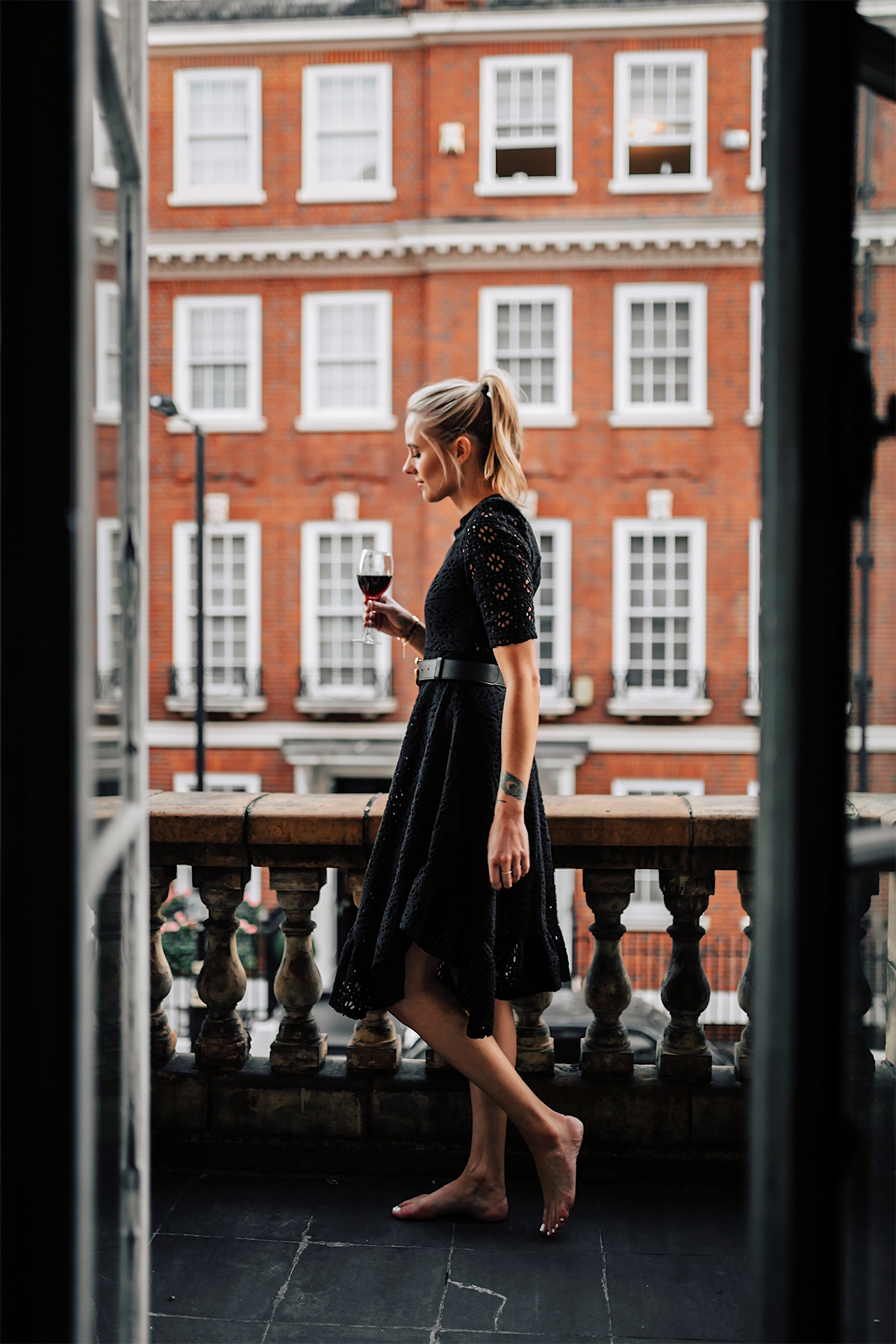 Blonde Women Wearing Black Lace Dress on London Balcony