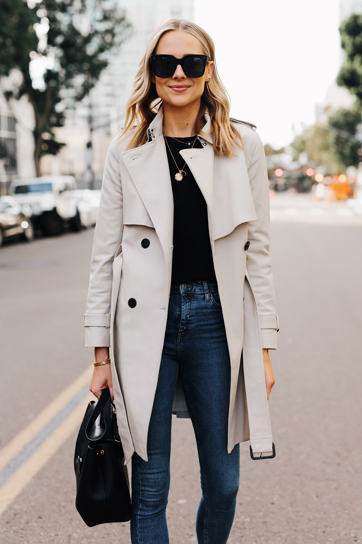 Blonde Woman Wearing Club Monaco Trench Coat Black Sweater Denim Skinny Jeans Black Handbag Fashion Jackson San Diego Fashion Blogger Street Style
