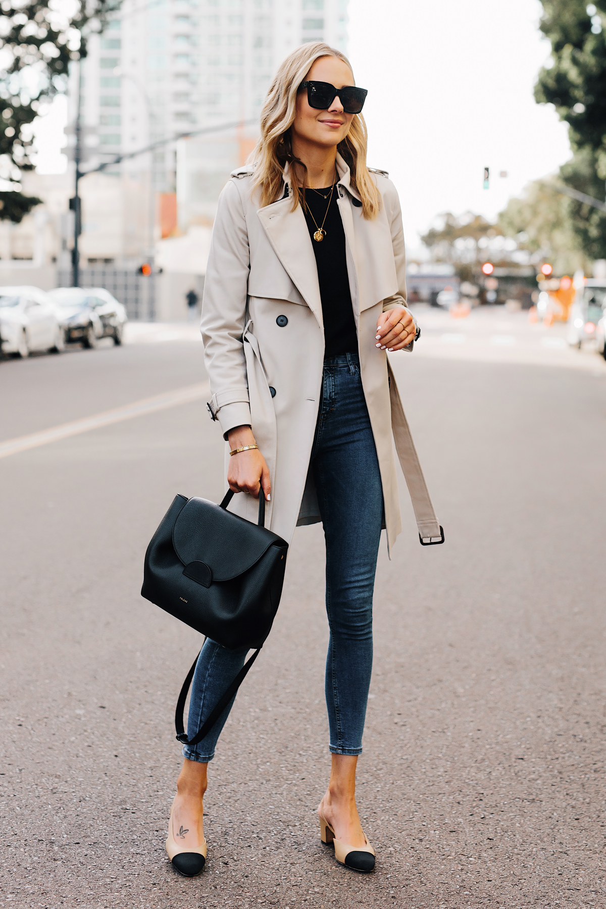 Blonde Woman Wearing Trench Coat Black Sweater Denim Skinny Jeans Chanel Slingbacks Polene Number One Handbag Monochrome Black Fashion Jackson San Diego Fashion Blogger Street Style