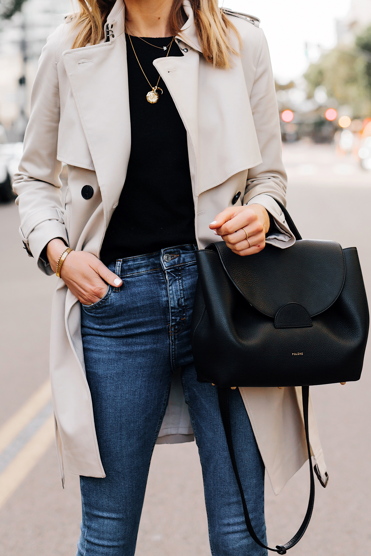 Blonde Woman Wearing Trench Coat Black Sweater Denim Skinny Jeans Polene Number One Handbag Monochrome Black Fashion Jackson San Diego Fashion Blogger Street Style