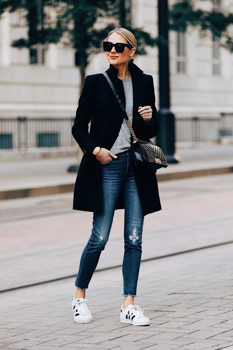 Blonde Woman Wearing Zara Black Wool Coat Grey Sweater Denim Ripped Skinny Jeans Adidas Sneakers Chanel Boy Bag Fashion Jackson Fashion Blogger Street Style