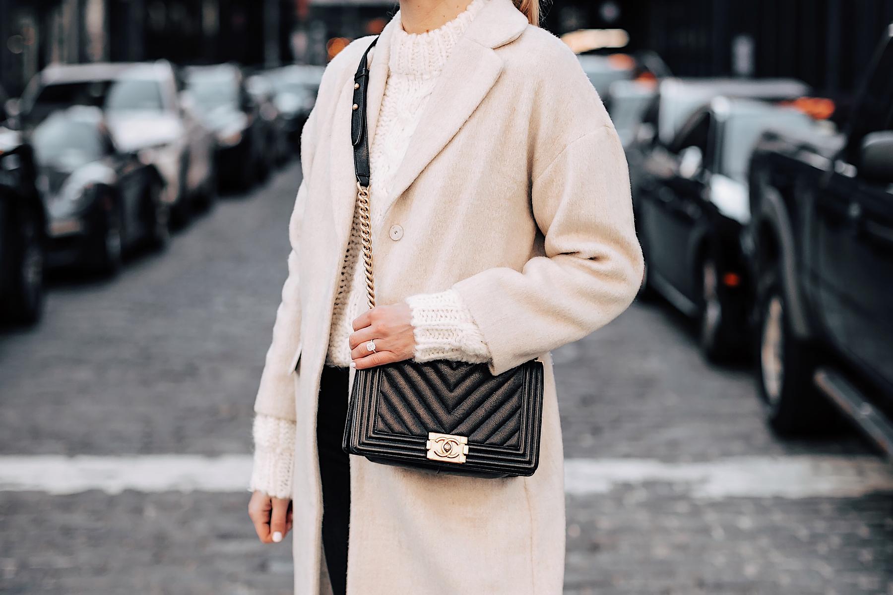 Blonde Woman Wearing Anine Bing White Knit Sweater Beige Wool Coat Chanel Black Boy Bag Fashion Jackson Fashion Blogger NYFW Street Style