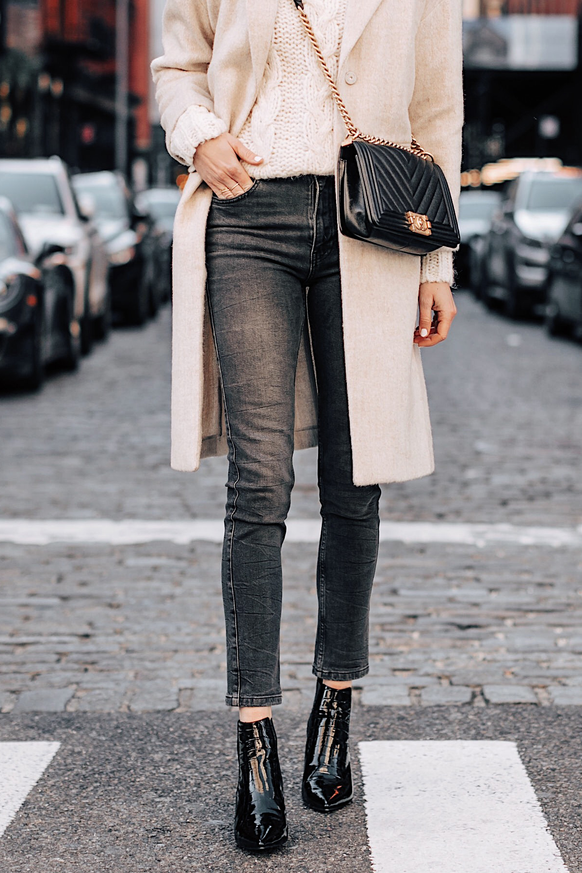 Woman Wearing Anine Bing White Knit Sweater Grey Skinny Jeans Beige Wool Coat Black Ankle Booties Chanel Black Boy Bag Fashion Jackson Fashion Blogger NYFW Street Style