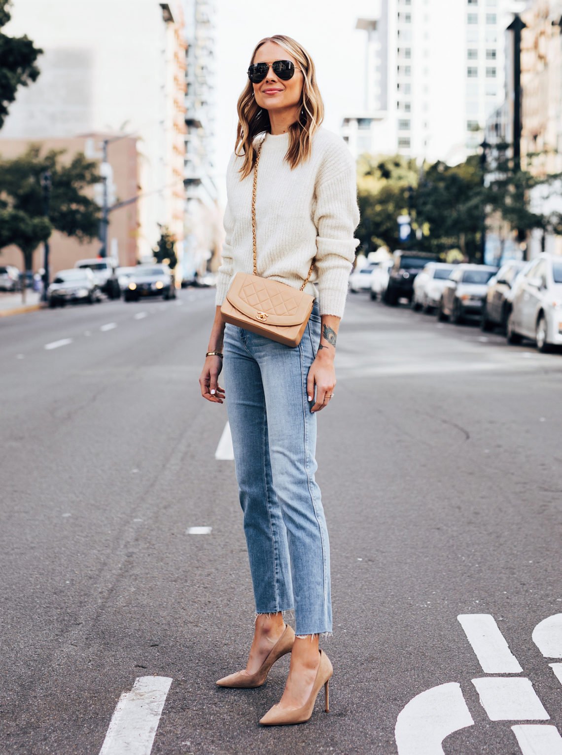 Fashion Jackson Wearing Reformation Ivory Sweater Frame Raw Hem Straight Leg Jeans Jimmy Choo Romy Nude Pumps Chanel Tan Diana Bag Featured Image