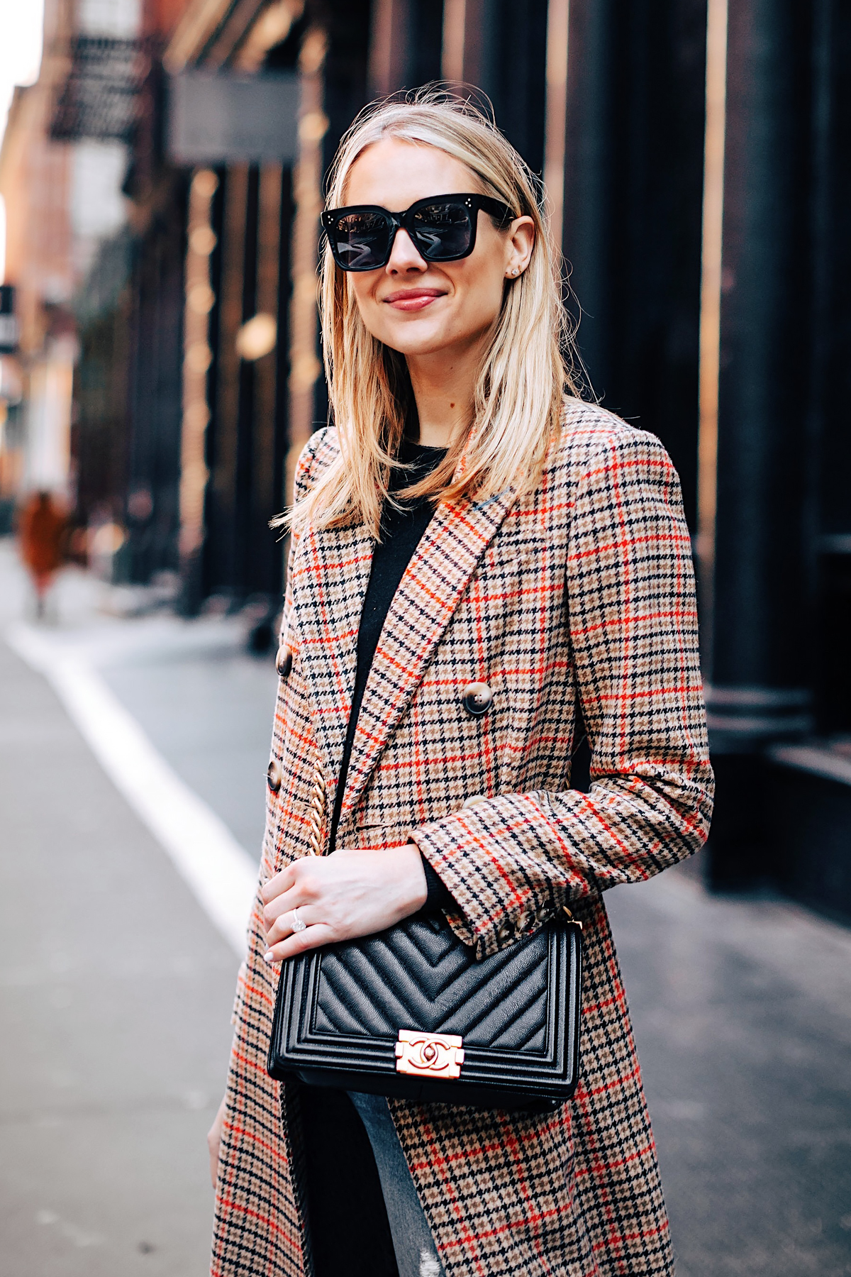 Blonde Woman Wearing Topshop Plaid Long Coat Black Sweater Chanel Boy Bag Black Fashion Jackson Fashion Blogger NYFW Street Style