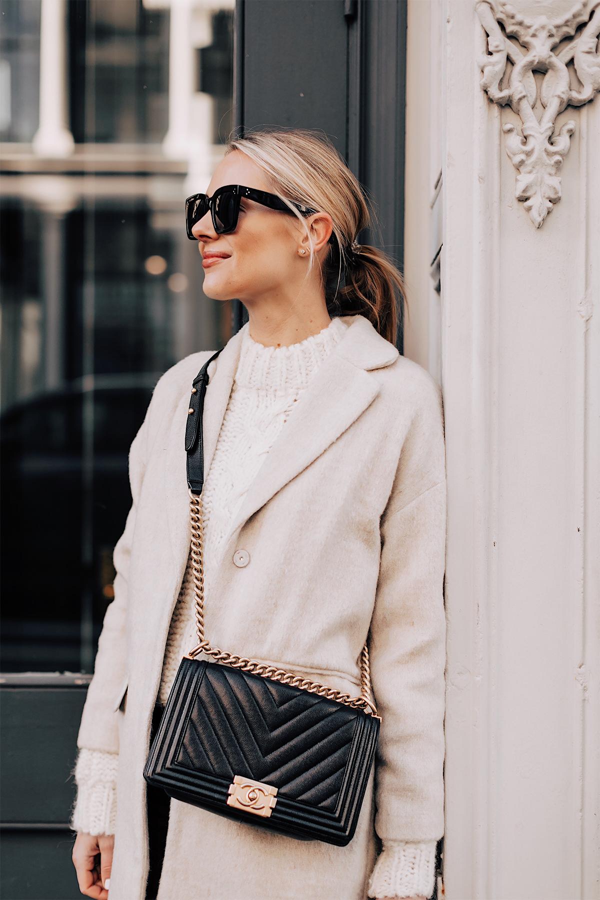 Blonde Woman Wearing White Knit Sweater Beige Wool Coat Chanel Black Boy Bag Fashion Jackson Fashion Blogger NYFW Street Style