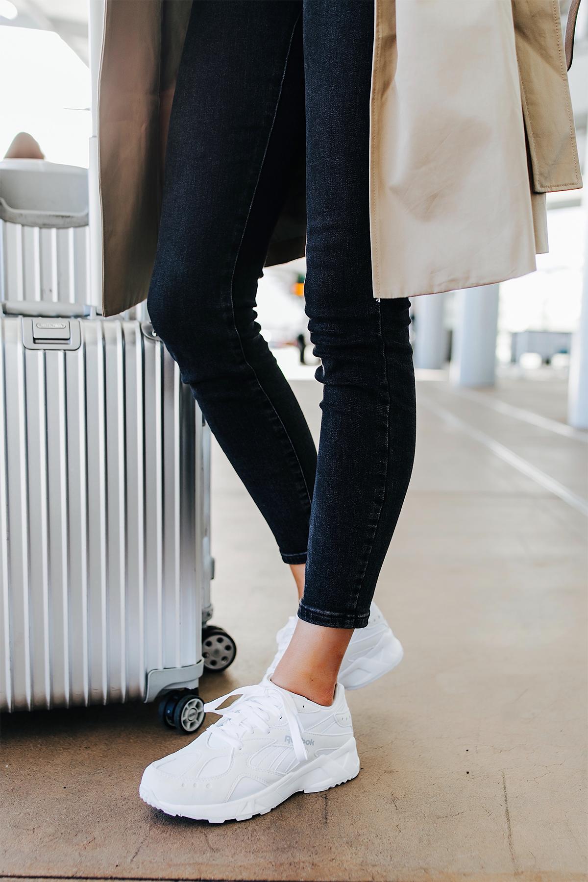 Woman Wearing Airport Travel Outfit Black Skinny Jeans Reebok Aztrek White Sneakers Rimowa Luggage Fashion Jackson San Diego Fashion Blogger Street Style