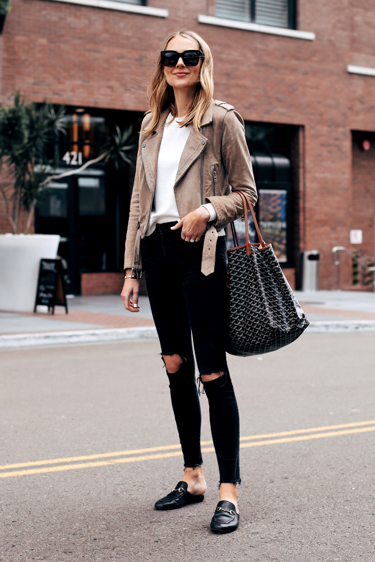 Fashion Jackson Capsule Wardrobe Wearing Blanknyc Tan Suede Moto Jacket White Sweater Madewell Black Ripped Skinny Jeans Gucci Black Mules Goyard Tote