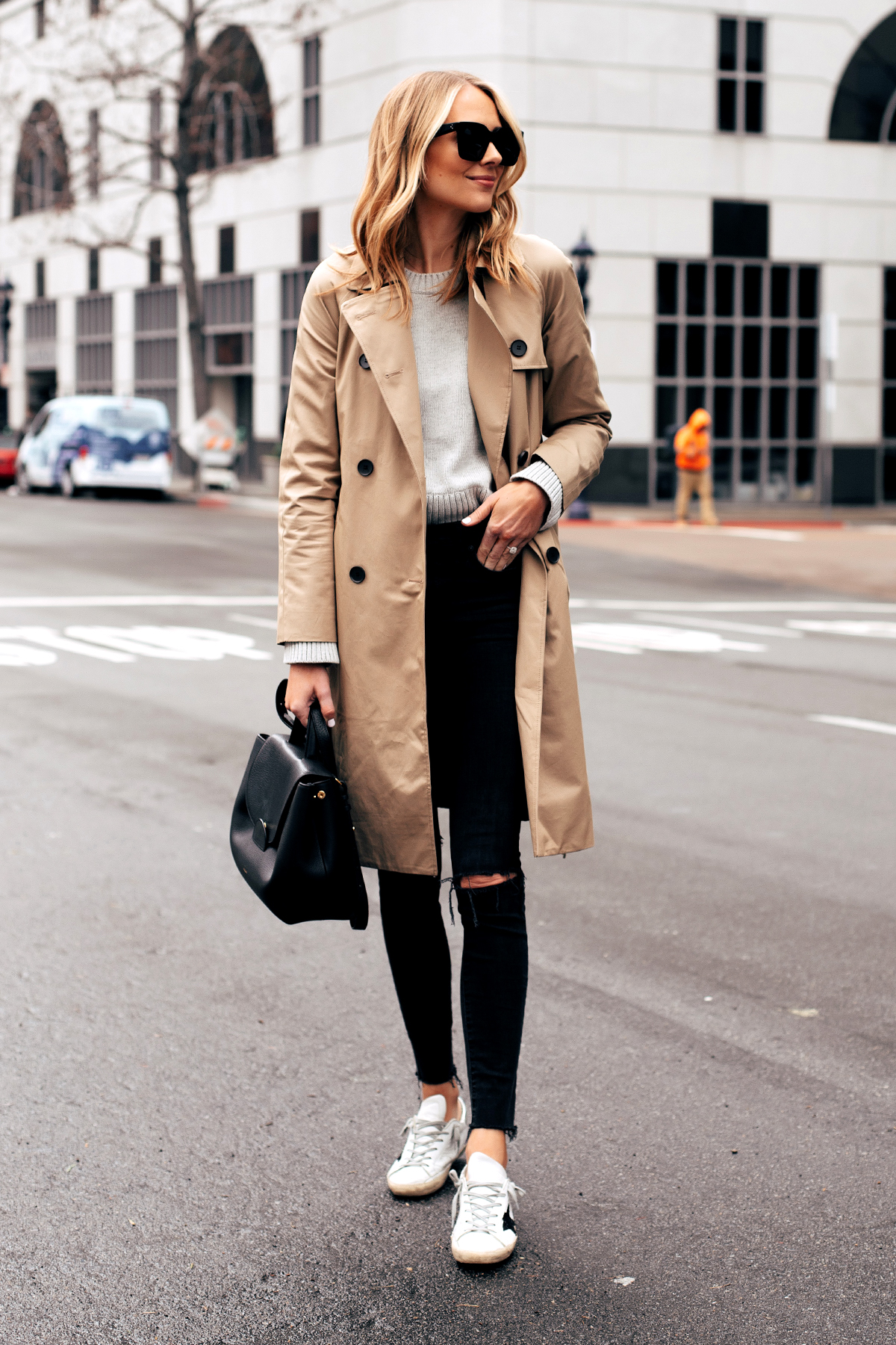 Fashion Jackson Capsule Wardrobe Wearing Everlane Trench Coat Grey Sweater Madewell Black Ripped Jeans Golden Goose Sneakers