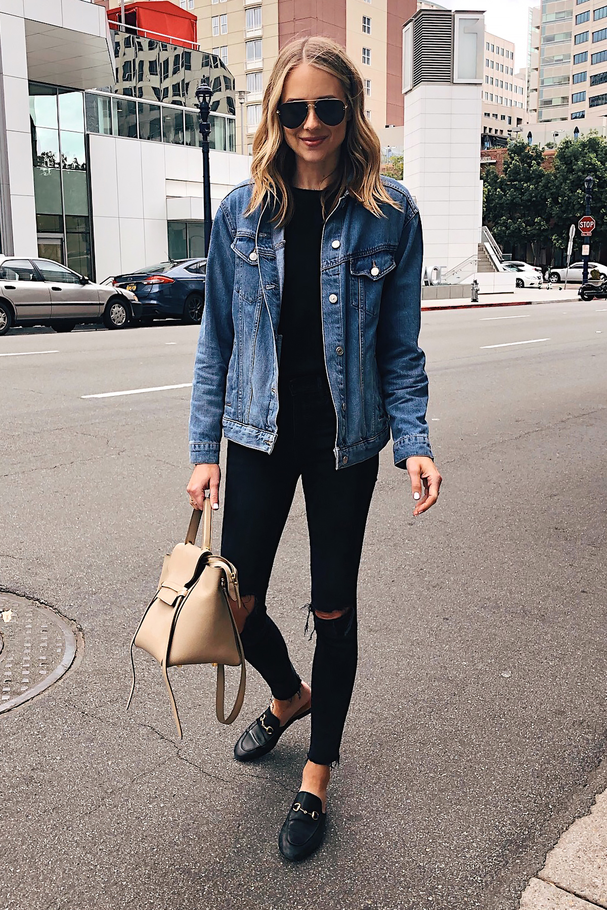 Fashion Jackson Capsule Wardrobe Wearing Topshop Oversized Denim Jacket Black Sweater Madewell Black Skinny Jeans Gucci Black Mules Celine Mini Belt Bag