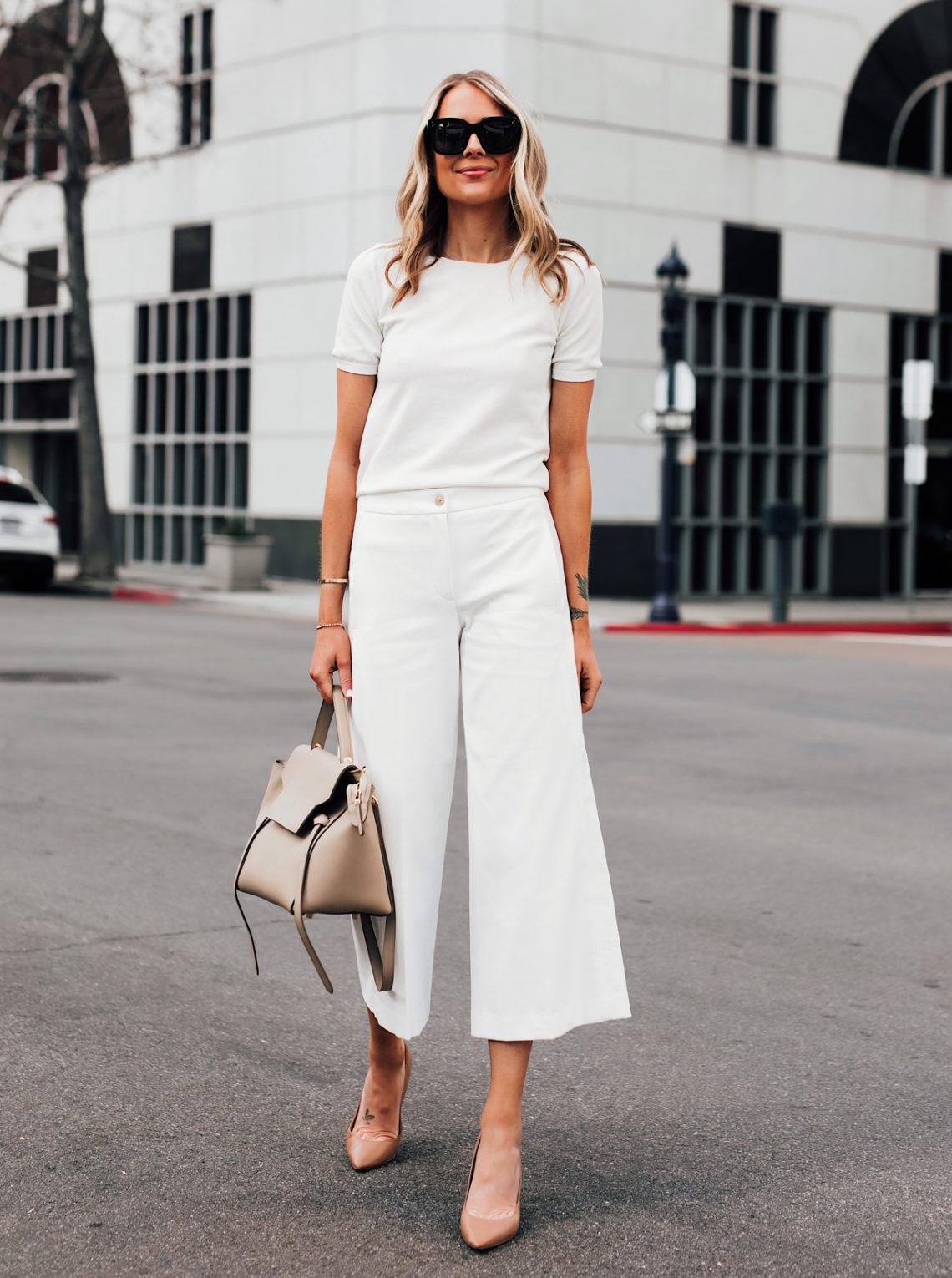 Fashion Jackson Wearing Ann Taylor White Short Sleeve Sweater Ann Taylor White Wide Leg Cropped Pants Nude Pumps Featured Image