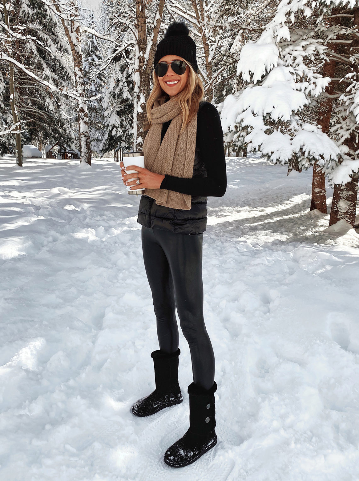 Fashion Jackson Wearing Black Beanie Camel Cashmere Scarf Puffer Vest Black Faux Leather Leggings Black Ugg Boots Winter Ski Trip