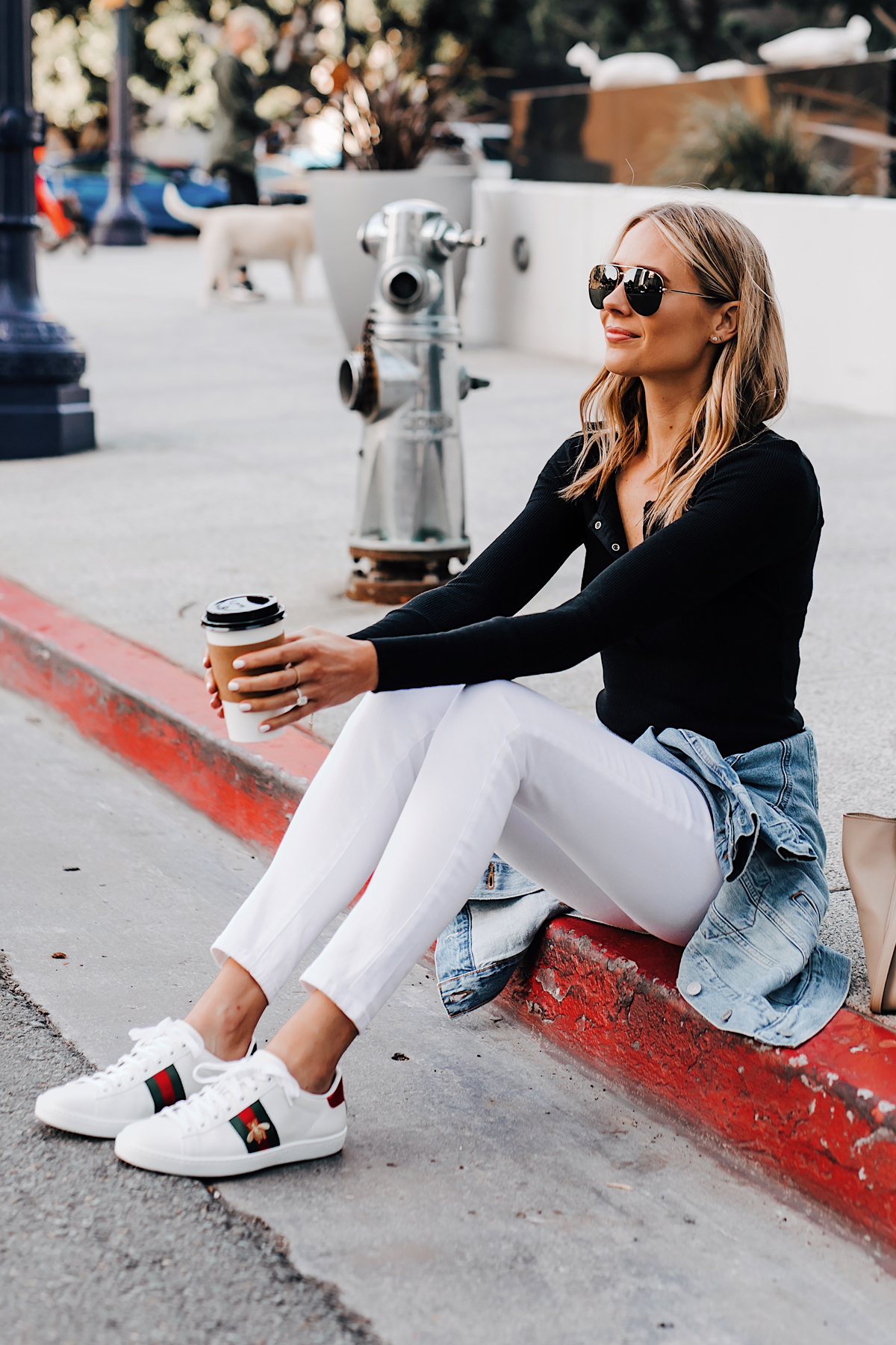 Blonde Woman Wearing Black Henley Joes Jeans White Skinny Jeans Levis Denim Jacket Gucci Ace Embroidered Sneakers Fashion Jackson San Diego Fashion Blogger Street Style