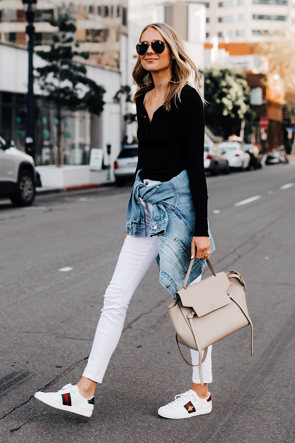 Blonde Woman Wearing Black Henley Joes Jeans White Skinny Jeans Levis Denim Jacket Gucci Ace Embroidered Sneakers Celine Mini Belt Bag Taupe Fashion Jackson San Diego Fashion Blogger Street Style