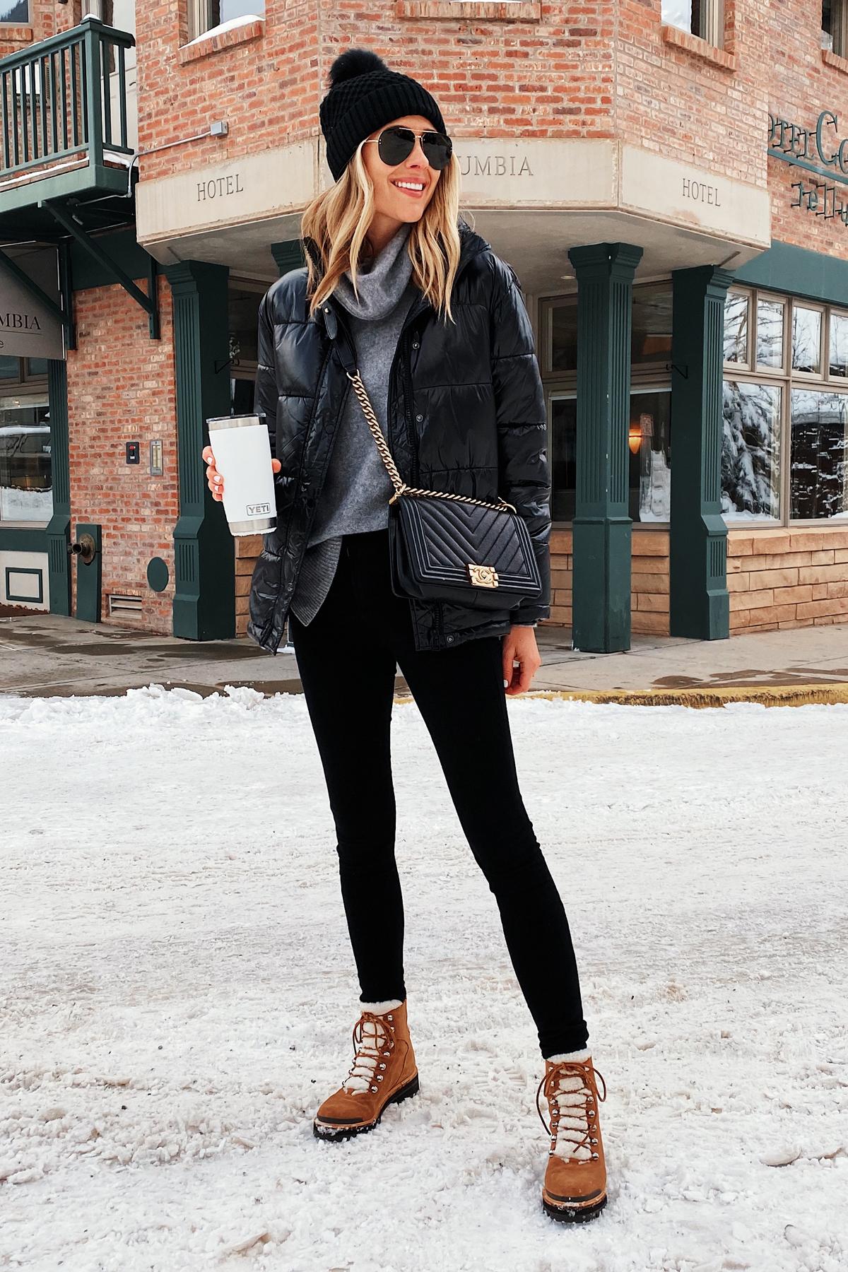 Fashion Jackson Wearing Black Puffer Coat Grey Turtleneck Sweater Black Jeans Winter Boots Black Beanie