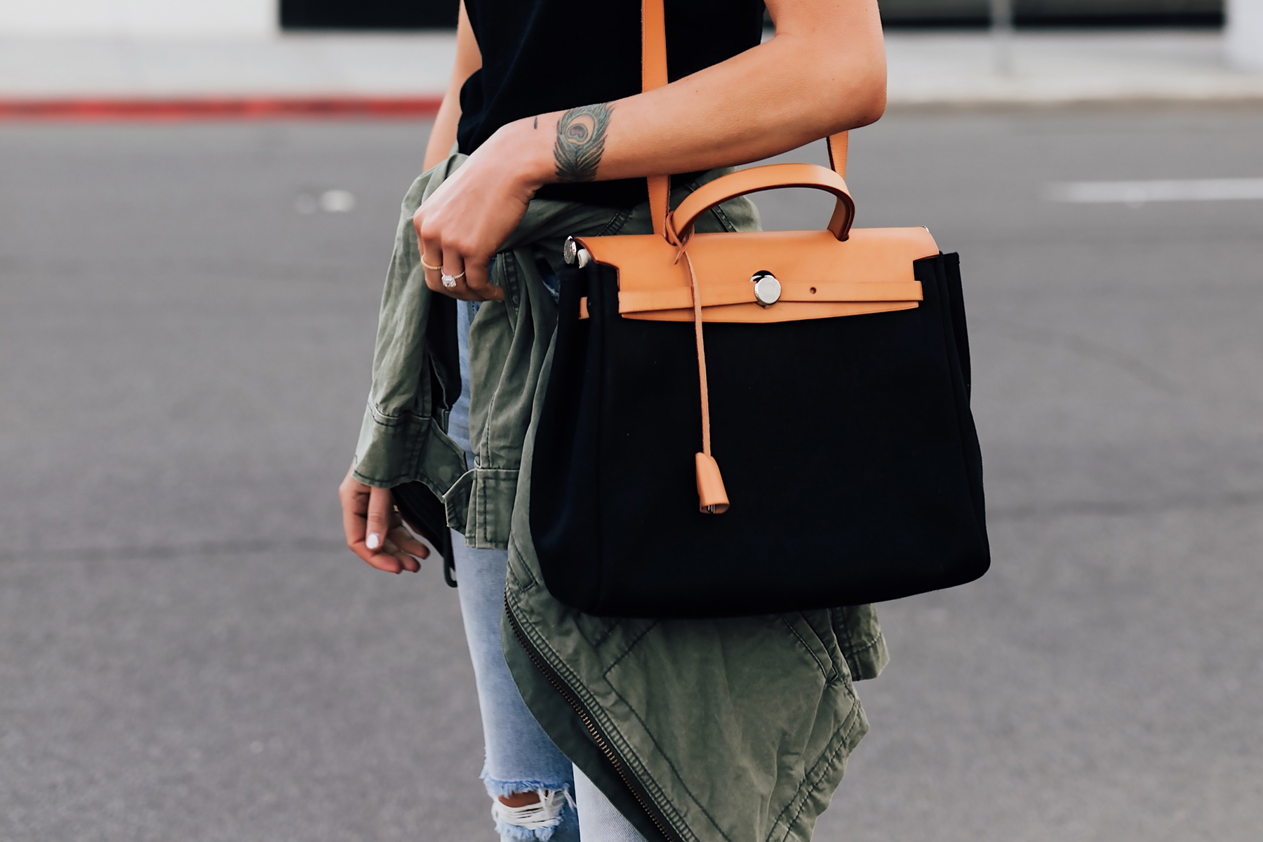 Woman Wearing Black Top Jeans Green Utility Jadcket eBay Authenticate Handbags Vintage Hermes Herbag Black Tan Handbag Fashion Jackson San Diego Fashion Blogger Street Style