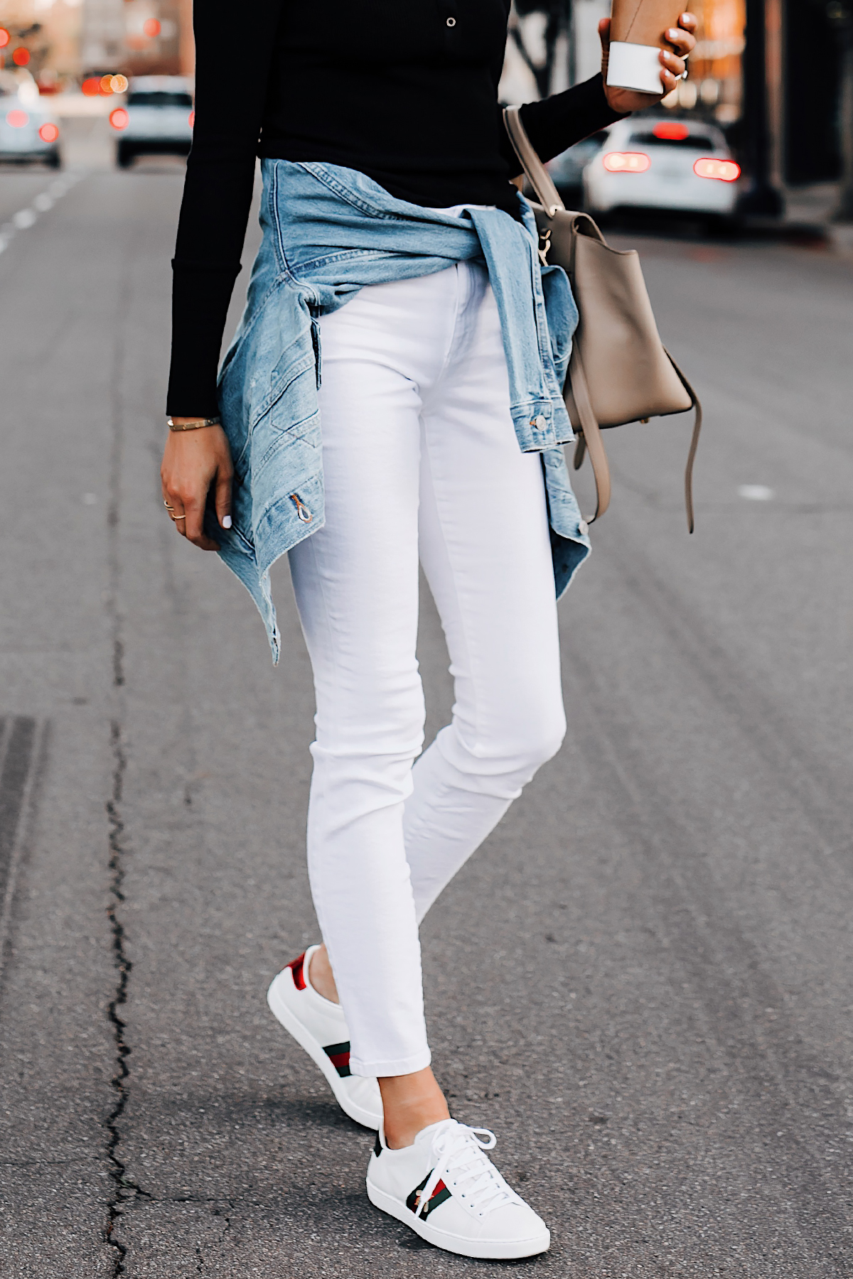 Woman Wearing Black Top Joes Jeans White Skinny Jeans Levis Denim Jacket Gucci Ace Embroidered Sneakers Fashion Jackson San Diego Fashion Blogger Street Style