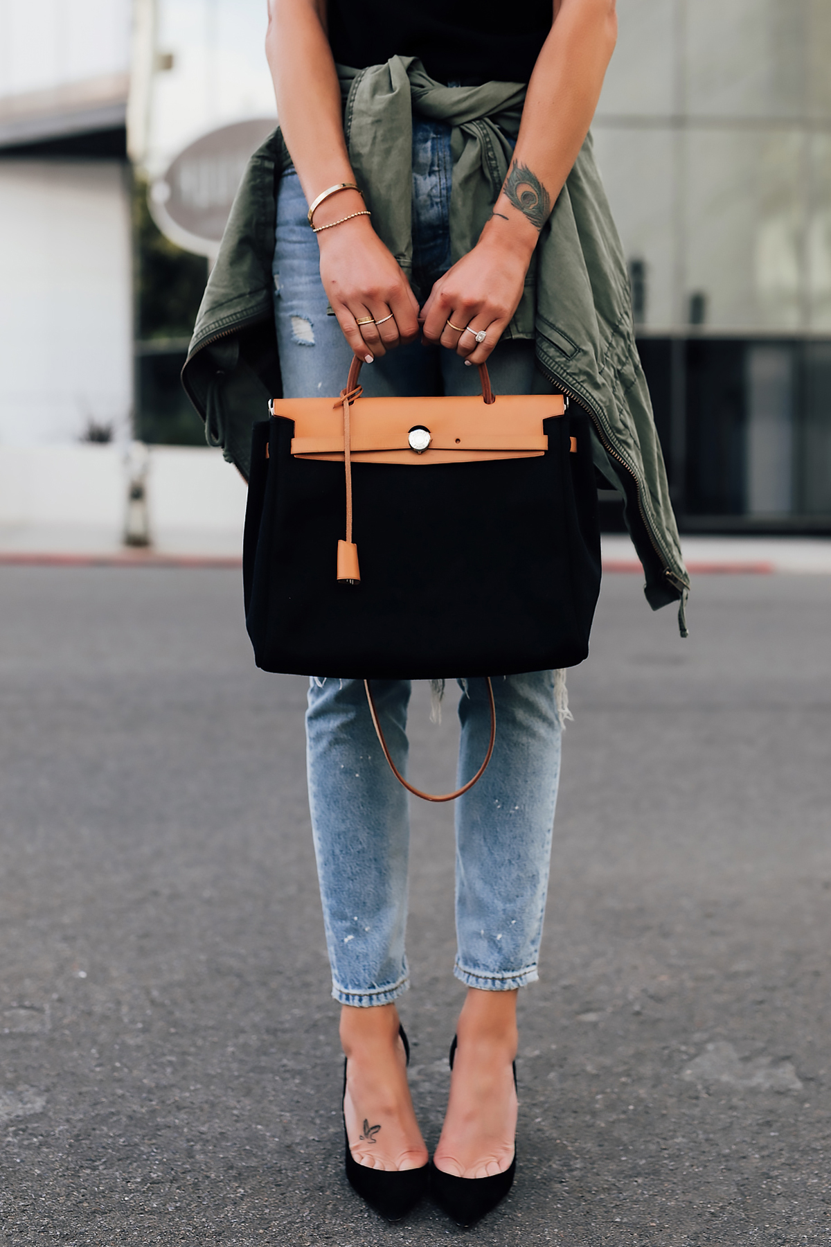 Woman Wearing Denim Ripped Skinny Jeans Green Utility Jacket Black Pumps Vintage Hermes Herbag Black Tan Fashion Jackson San Diego Fashion Blogger Street Style