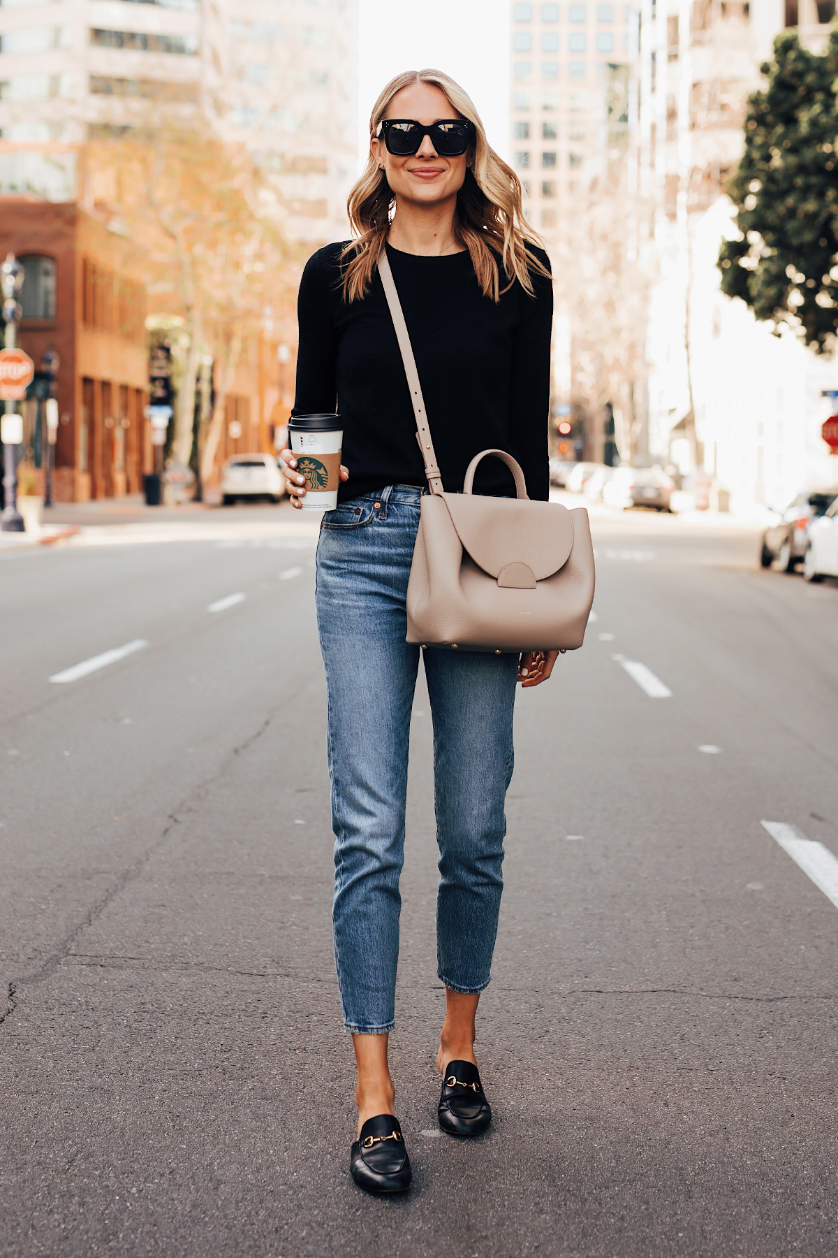 4140b162c6c Blonde Woman Wearing Everlane Black Cashmere Sweater Levis 501 Jeans Gucci  Princetown Mules Black Polene Numero