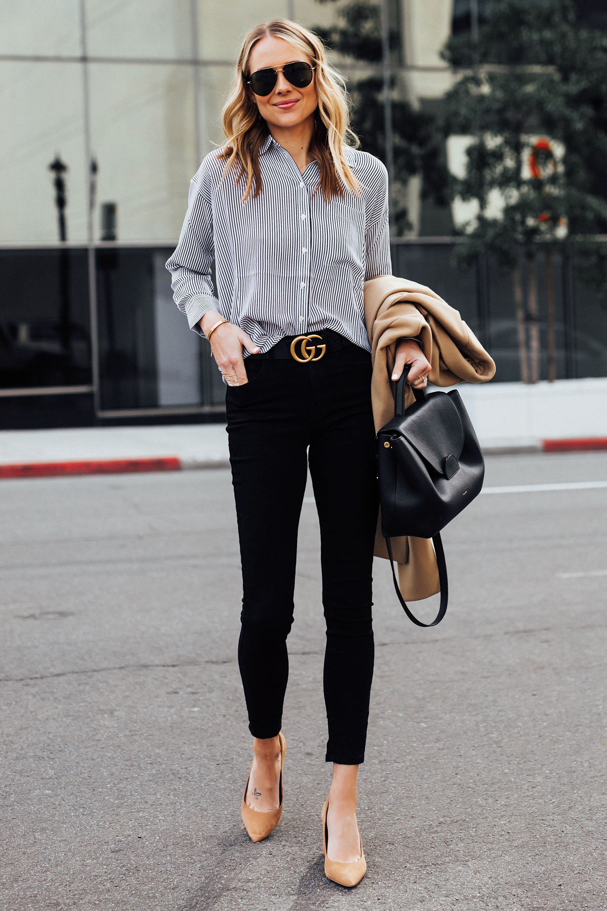 Blonde Woman Wearing Everlane Black White Stripe Button Down Shirt Black Skinny Jeans Black Gucci Belt Tan Pumps Polene Numero Un Black Handbag Camel Coat Fashion Jackson San Diego Fashion Blogger Street Style