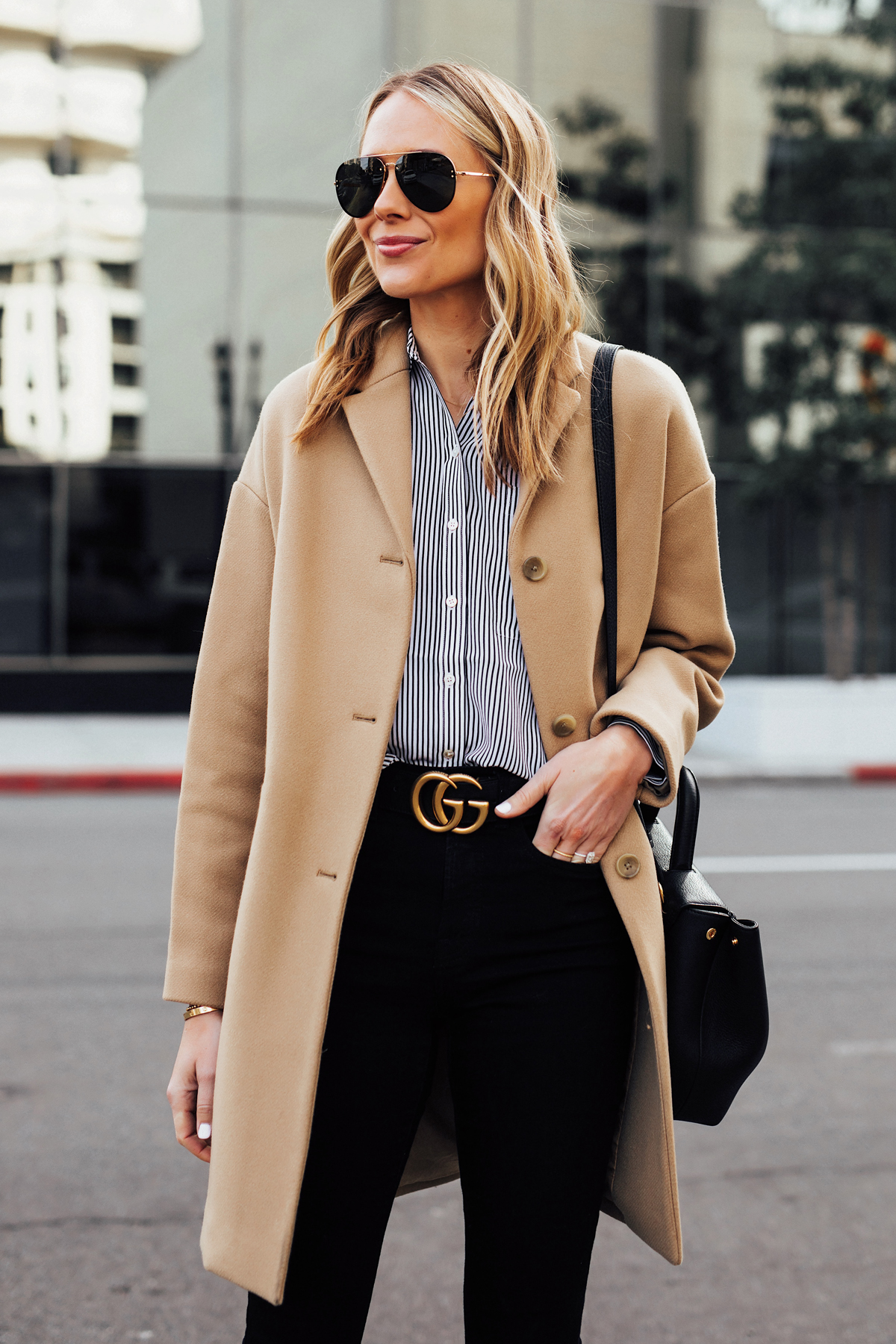 Blonde Woman Wearing Everlane Camel Coat Black White Stripe Button Down Shirt Black Skinny Jeans Black Gucci Belt Fashion Jackson San Diego Fashion Blogger Street Style