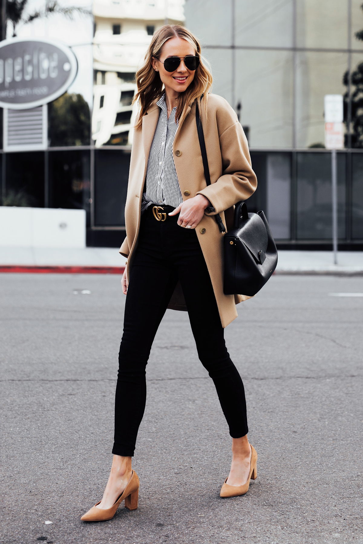 Blonde Woman Wearing Everlane Camel Coat Black White Stripe Button Down Shirt Black Skinny Jeans Black Gucci Belt Tan Pumps Polene Numero Un Black Handbag Fashion Jackson San Diego Fashion Blogger Street Style
