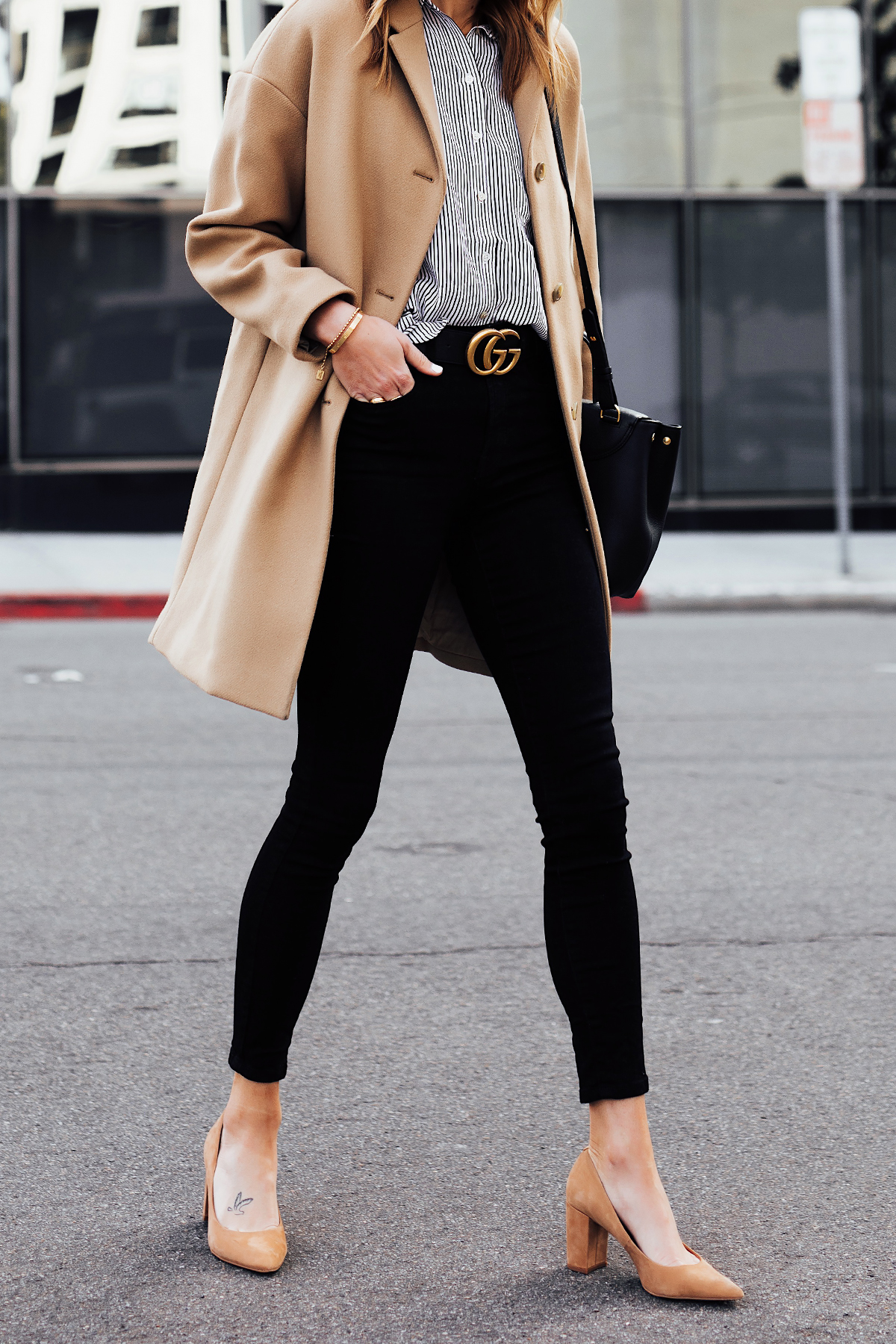 Woman Wearing Everlane Camel Coat Black White Stripe Button Down Shirt Black Skinny Jeans Black Gucci Belt Tan Pumps Fashion Jackson San Diego Fashion Blogger Street Style