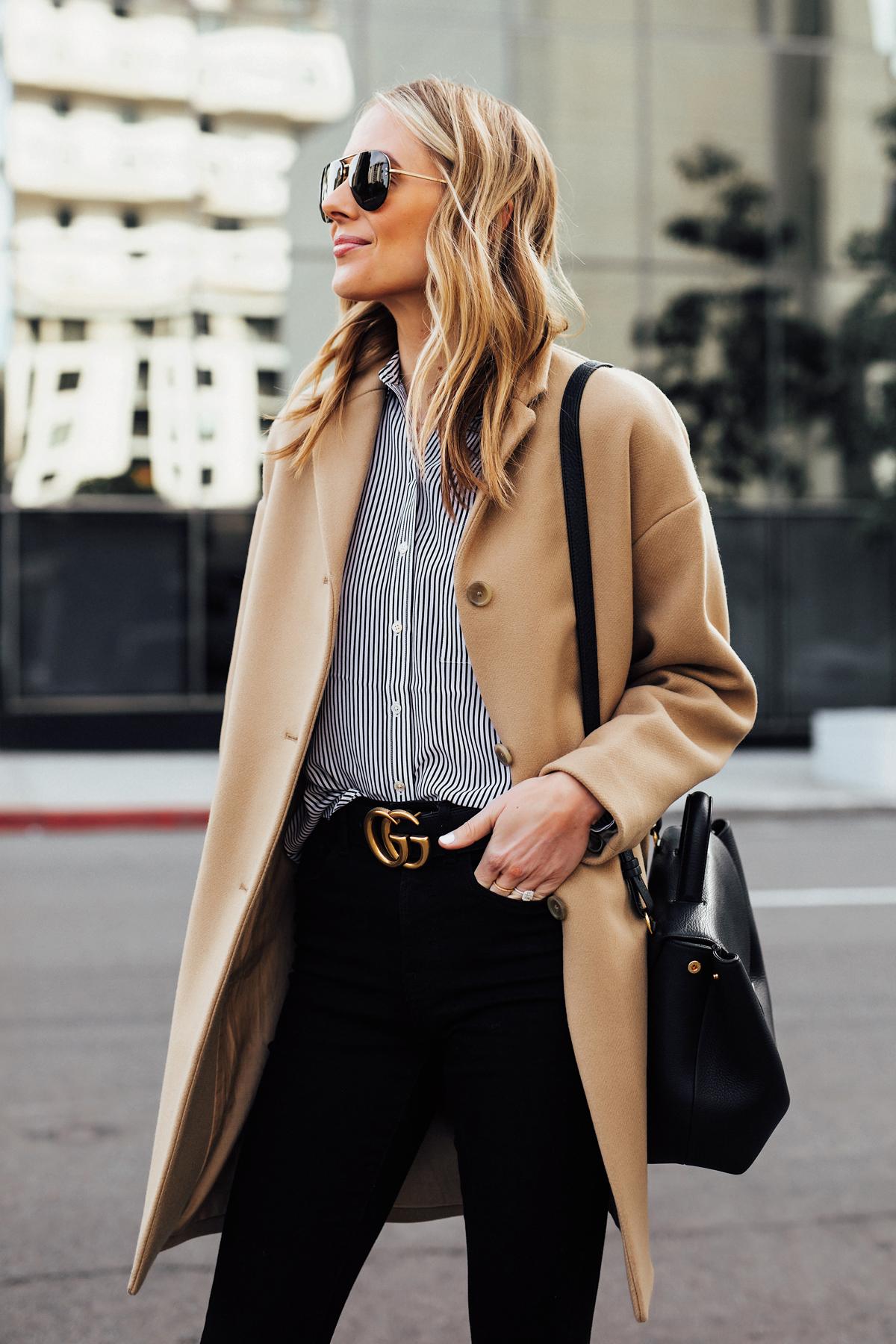 Blonde Woman Wearing Everlane Camel Coat Black White Stripe Button Down Shirt Black Skinny Jeans Black Gucci Belt Fashion Jackson San Diego Fashion Blogger Street Style