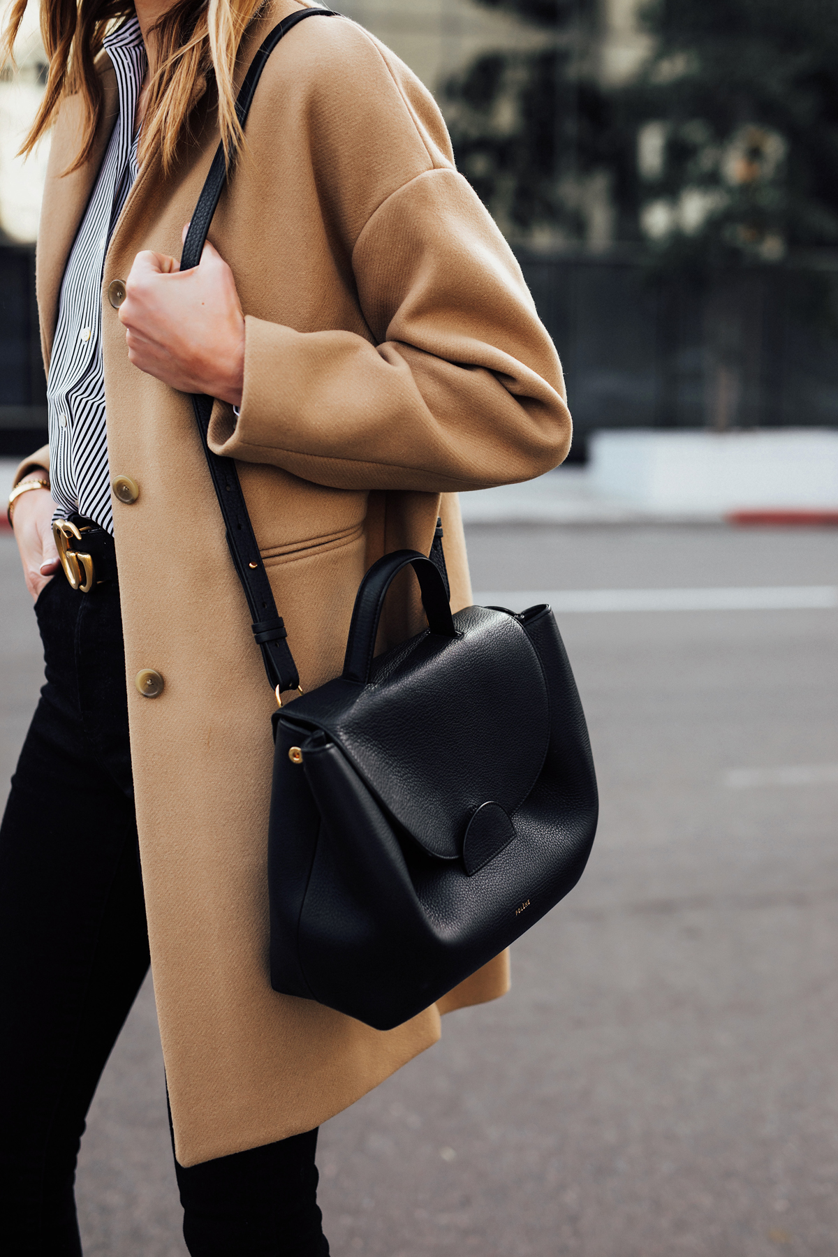 Blonde Woman Wearing Everlane Camel Coat Black White Striped Shirt Black Skinny Jeans Polene Numero Un Black Handbag Fashion Jackson San Diego Fashion Blogger Street Style