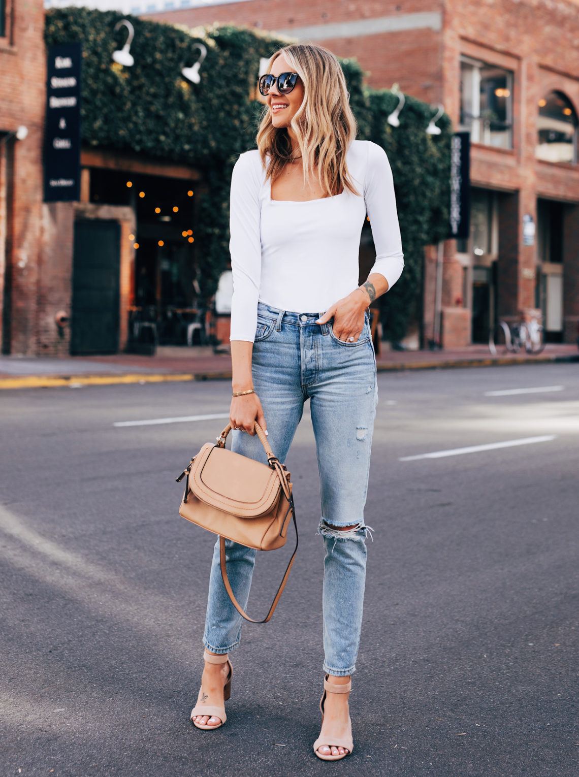 Blonde Woman Wearing Free People White Square Bodysuite Boyish Denim Jeans Sole Society Tan Heeled Sandals Sole Society Tan Crossbody Handbag Featured Image Fashion Jackson San Diego Fashion Blogger Street Style