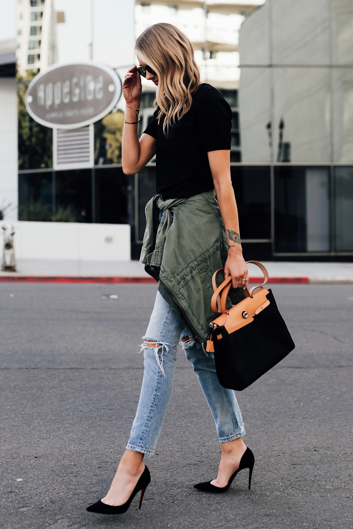 Blonde Woman Wearing Short Sleeve Black Top Denim Ripped Skinny Jeans Black Pumps Green Utility Jacket Vintage Hermes Herbag Black Tan Handbag Fashion Jackson San Diego Fashion Blogger Street Style